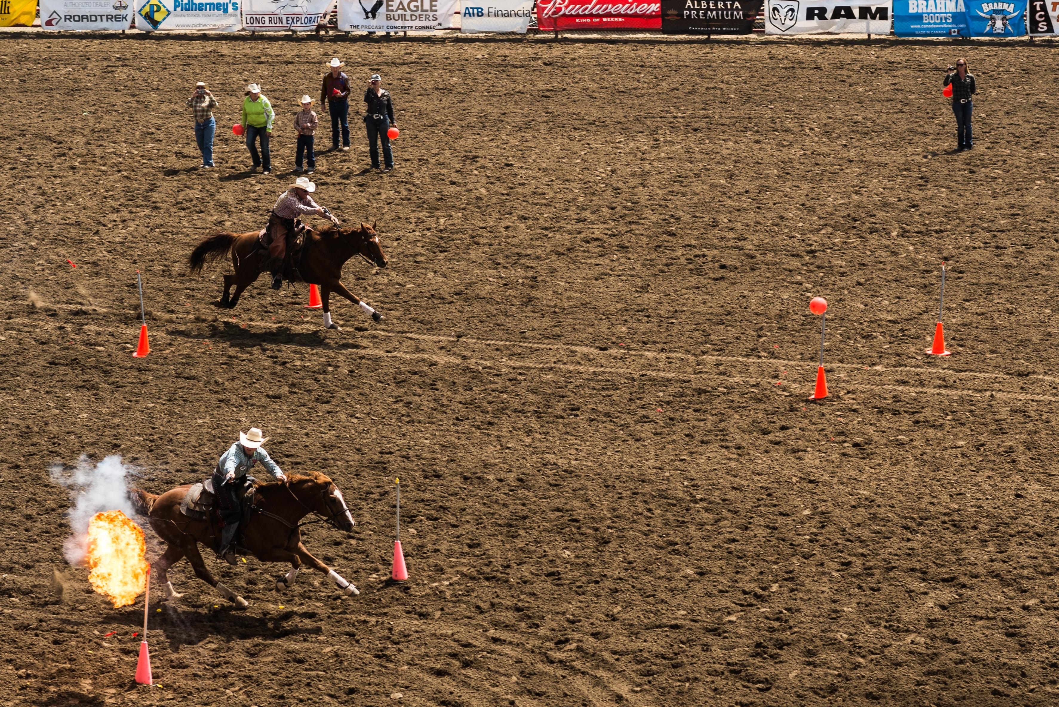 two men racing horseback riding
