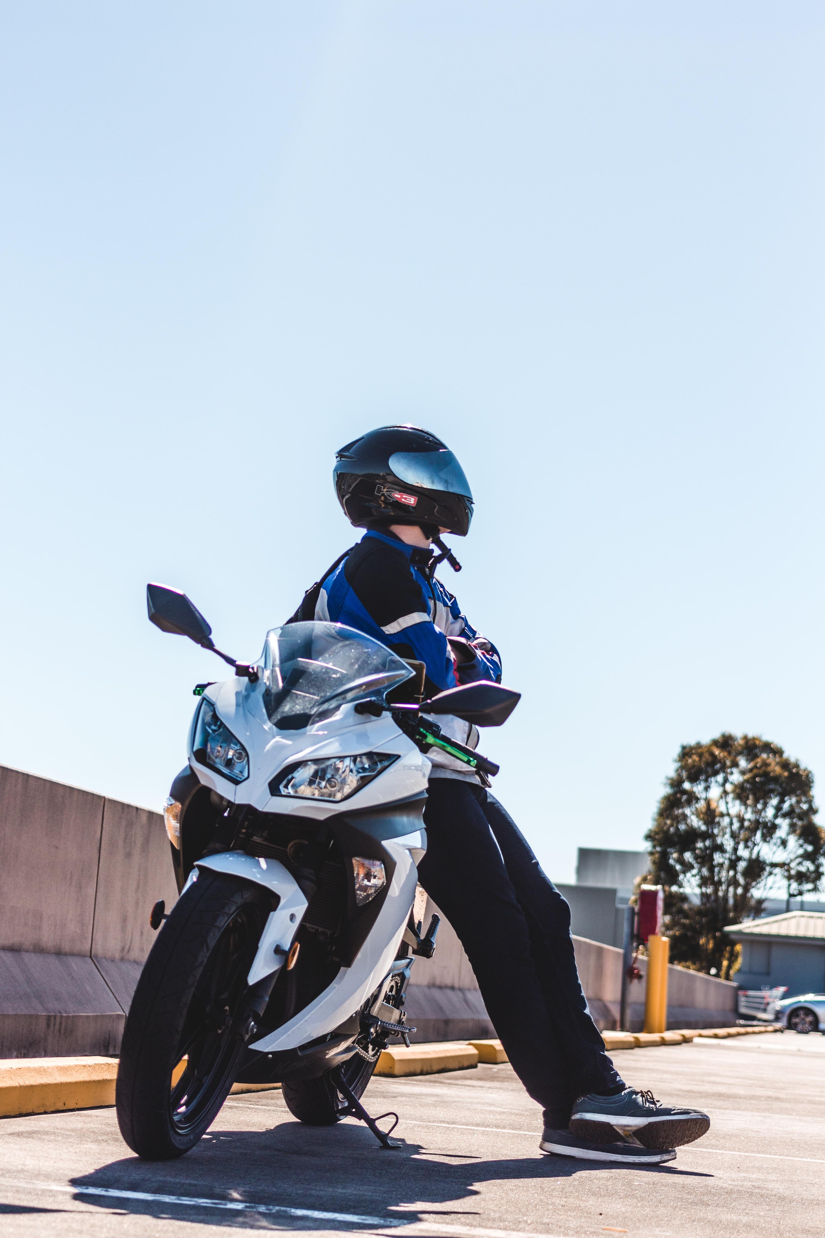 man sitting on sports bike