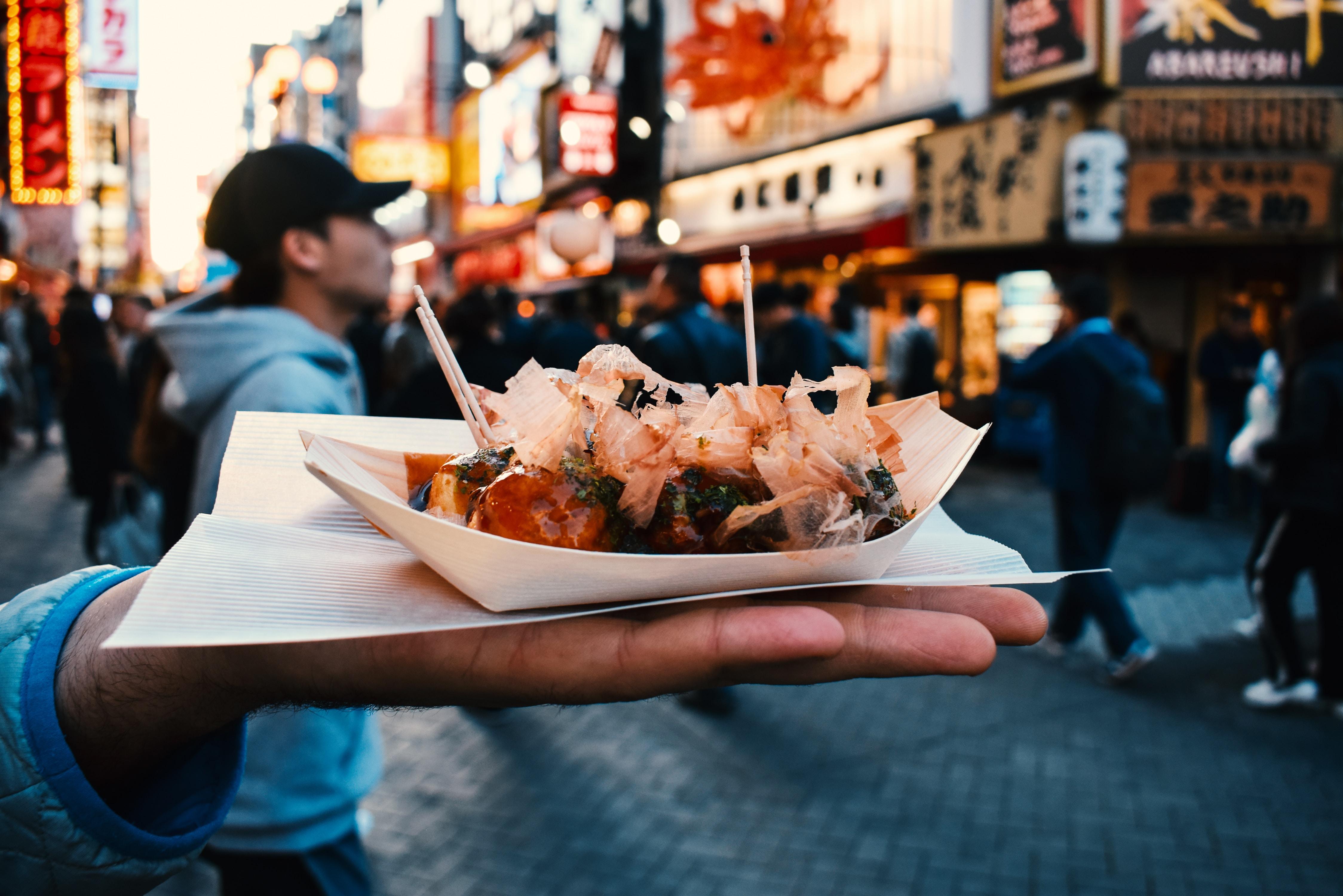 person holding steamed dumplings