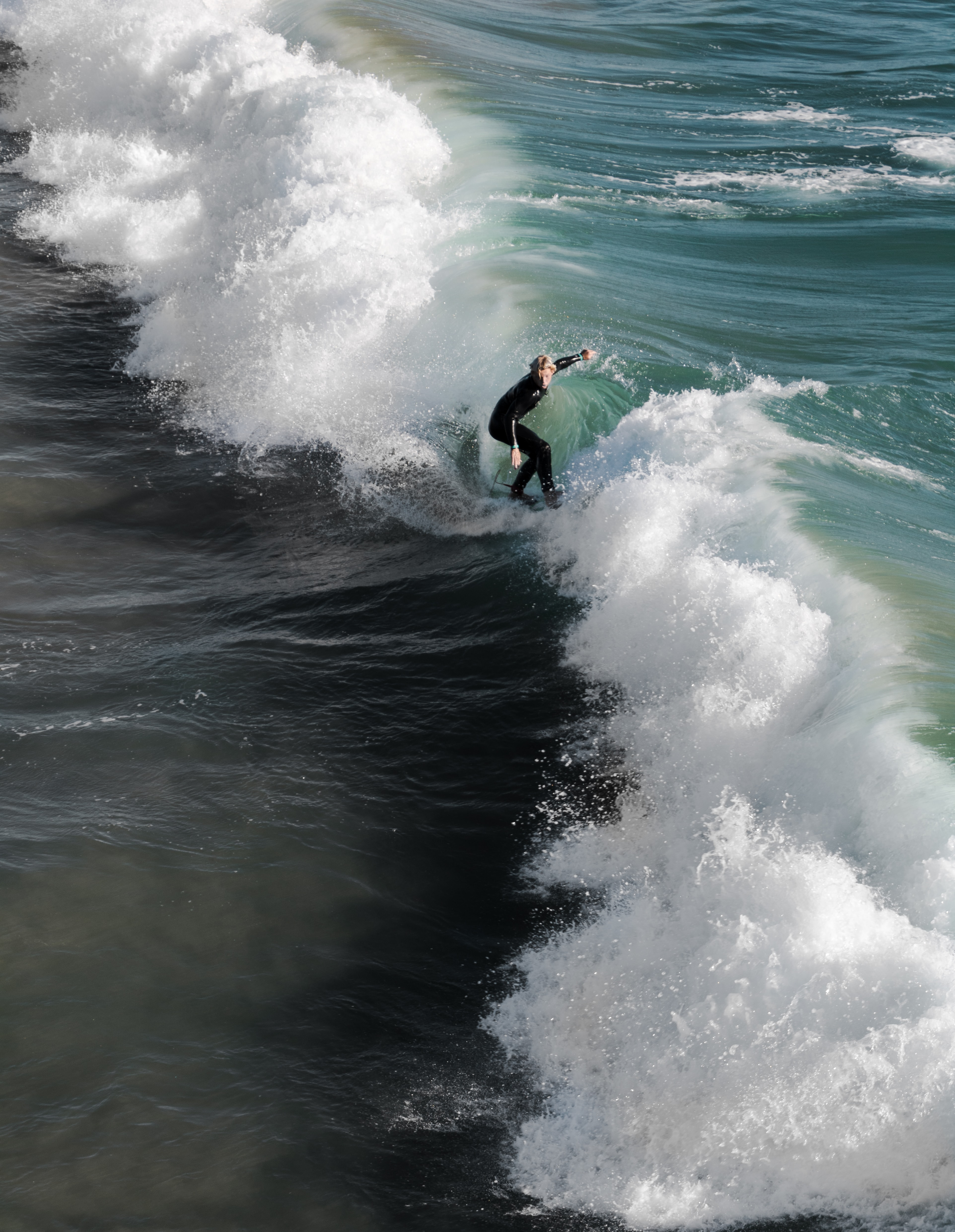 person surfing on sea waves at daytime