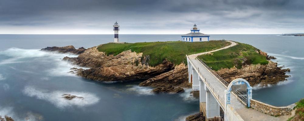 lighthouse on islet with bridge
