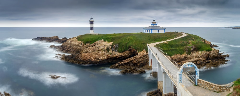 lighthouse on islet with bridge
