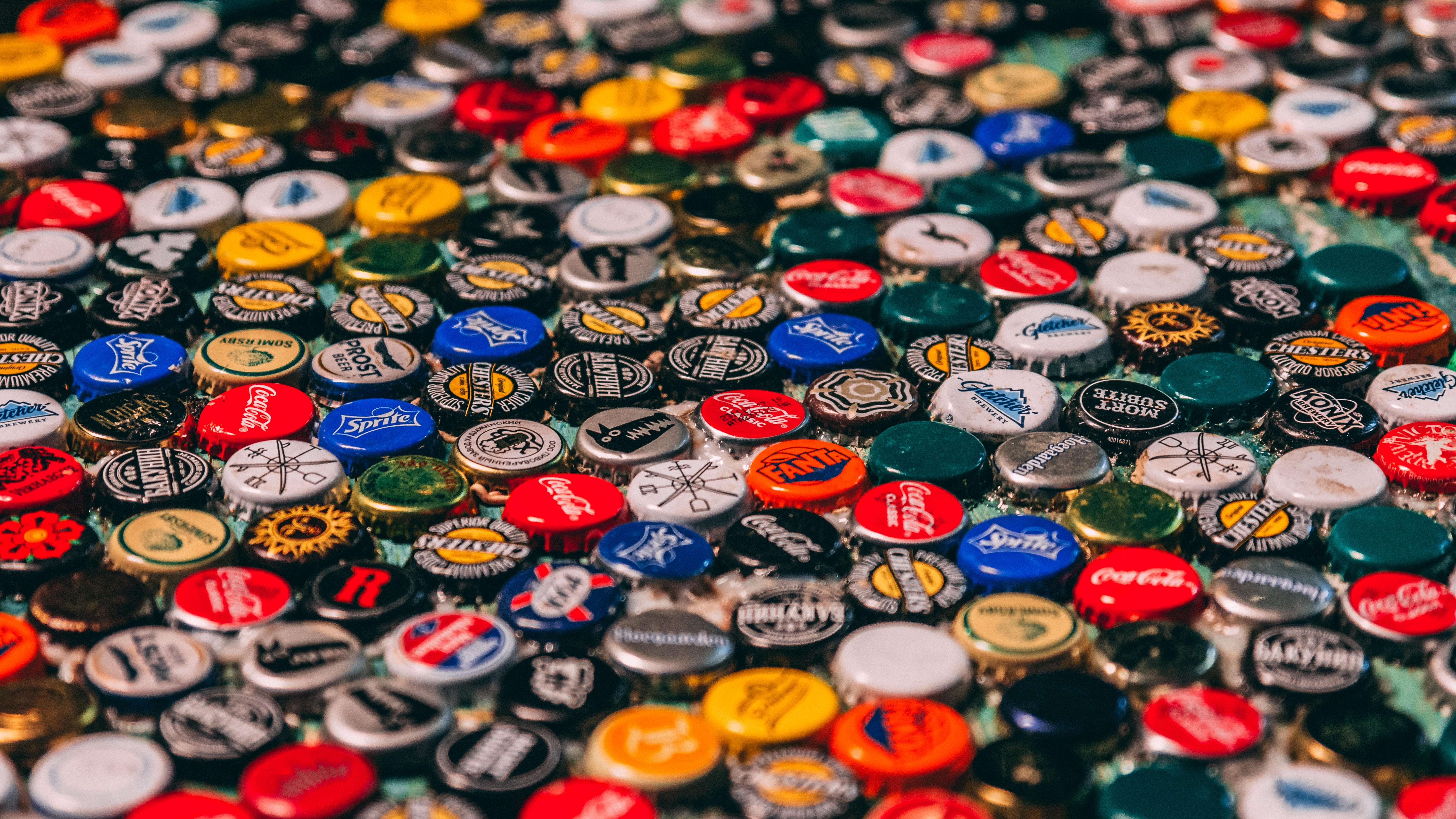 stack of assorted-color bottle caps