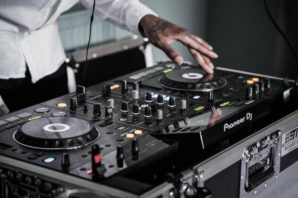 person touching black terminal mixer