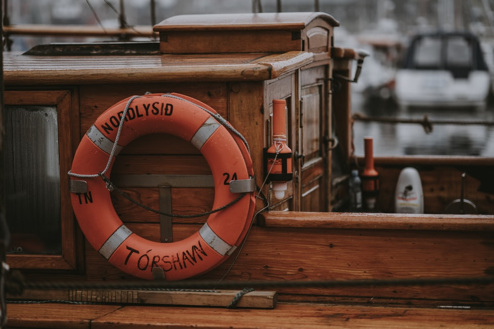 brown wooden boat close-up photo