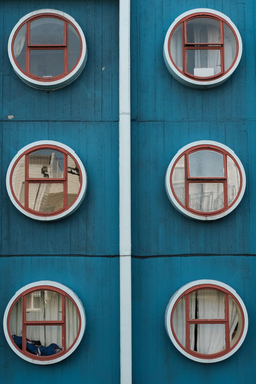 round gray glass windows close-up photo