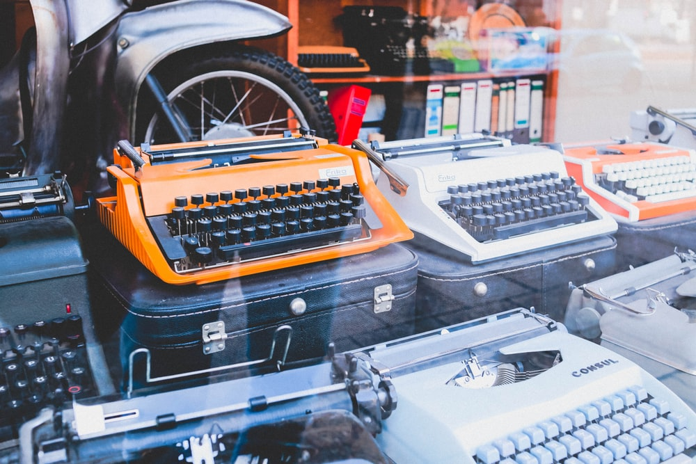 assorted colors of typewriters