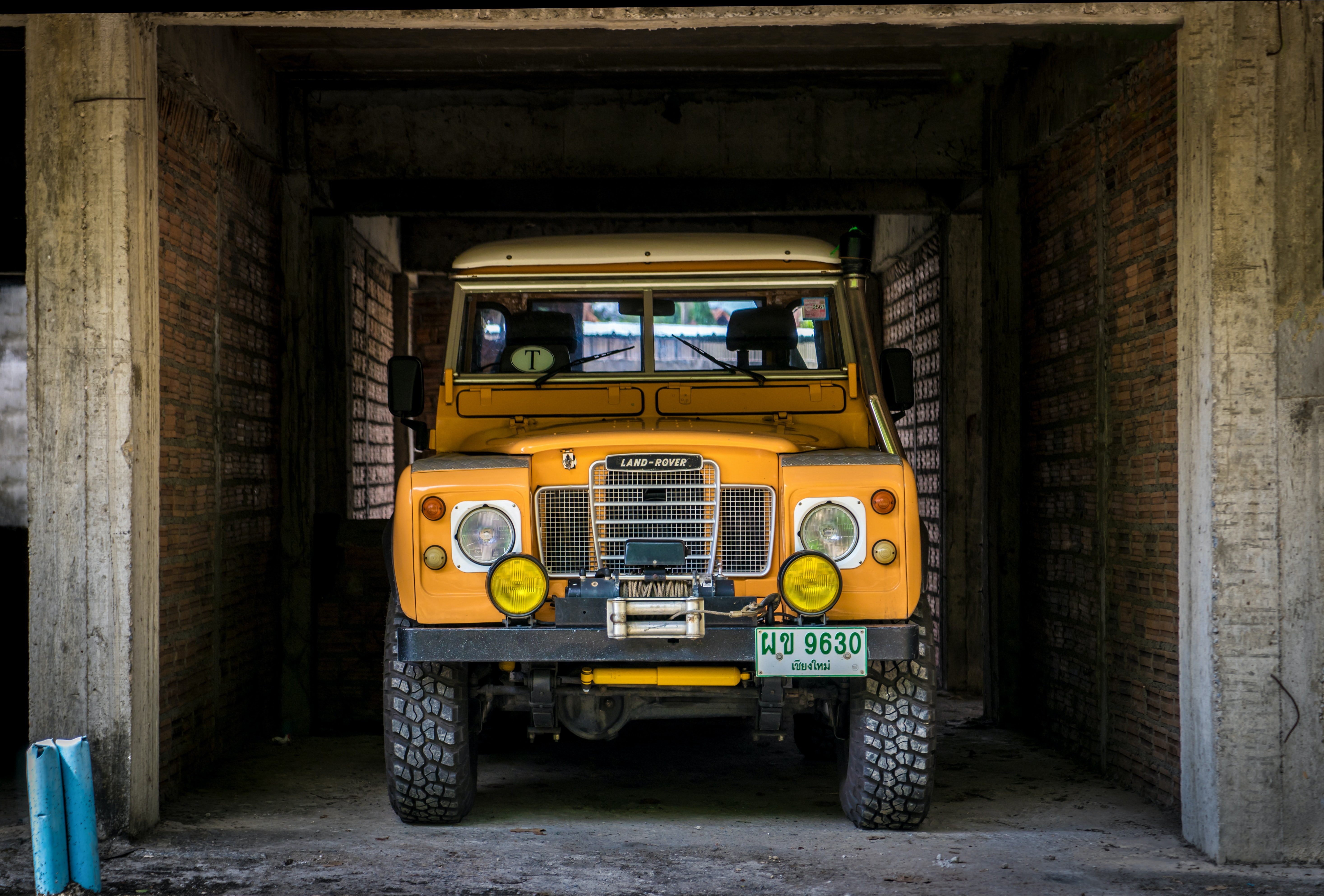 yellow vehicle parked inside building
