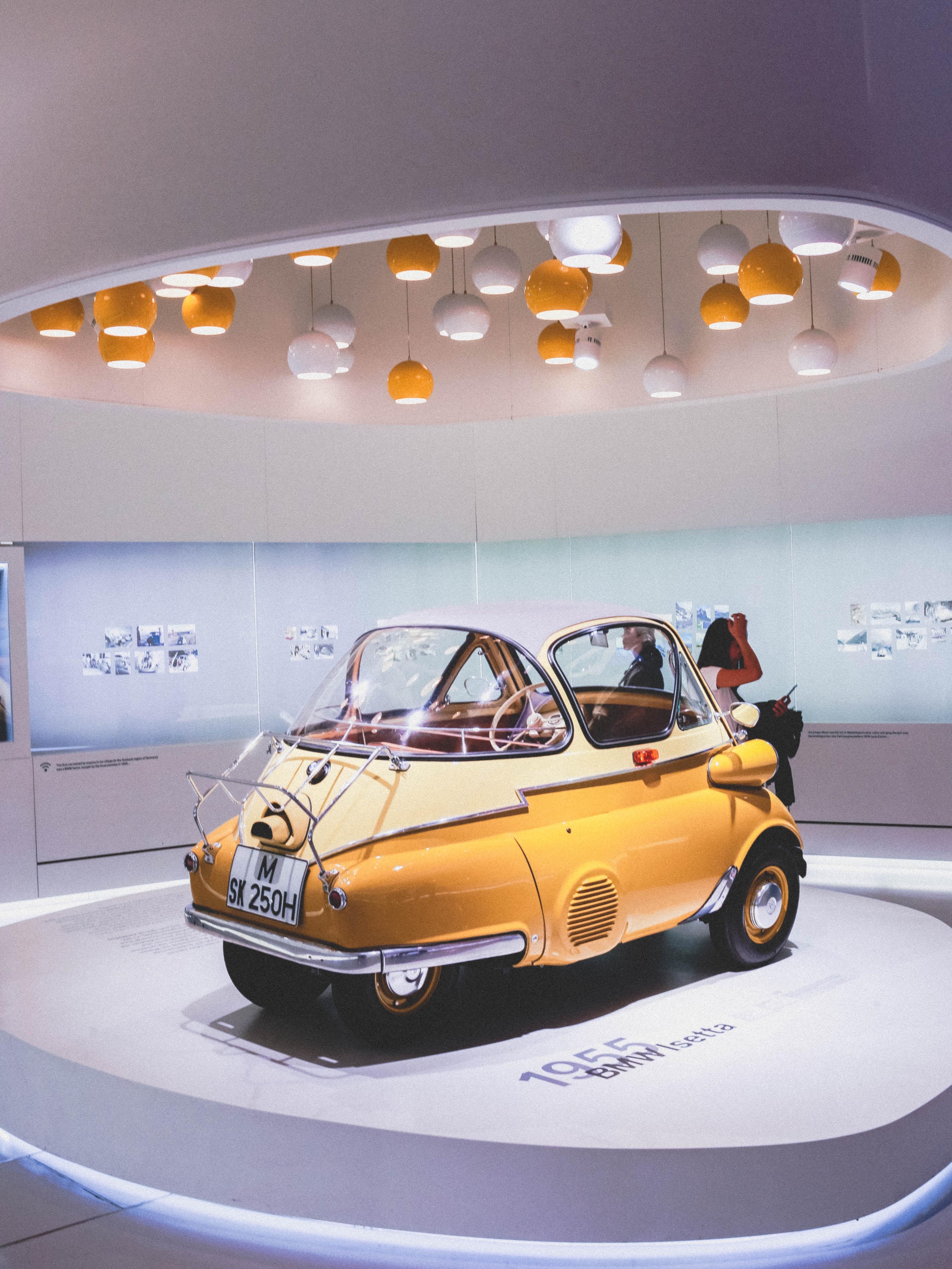 yellow and gray vehicle near wall