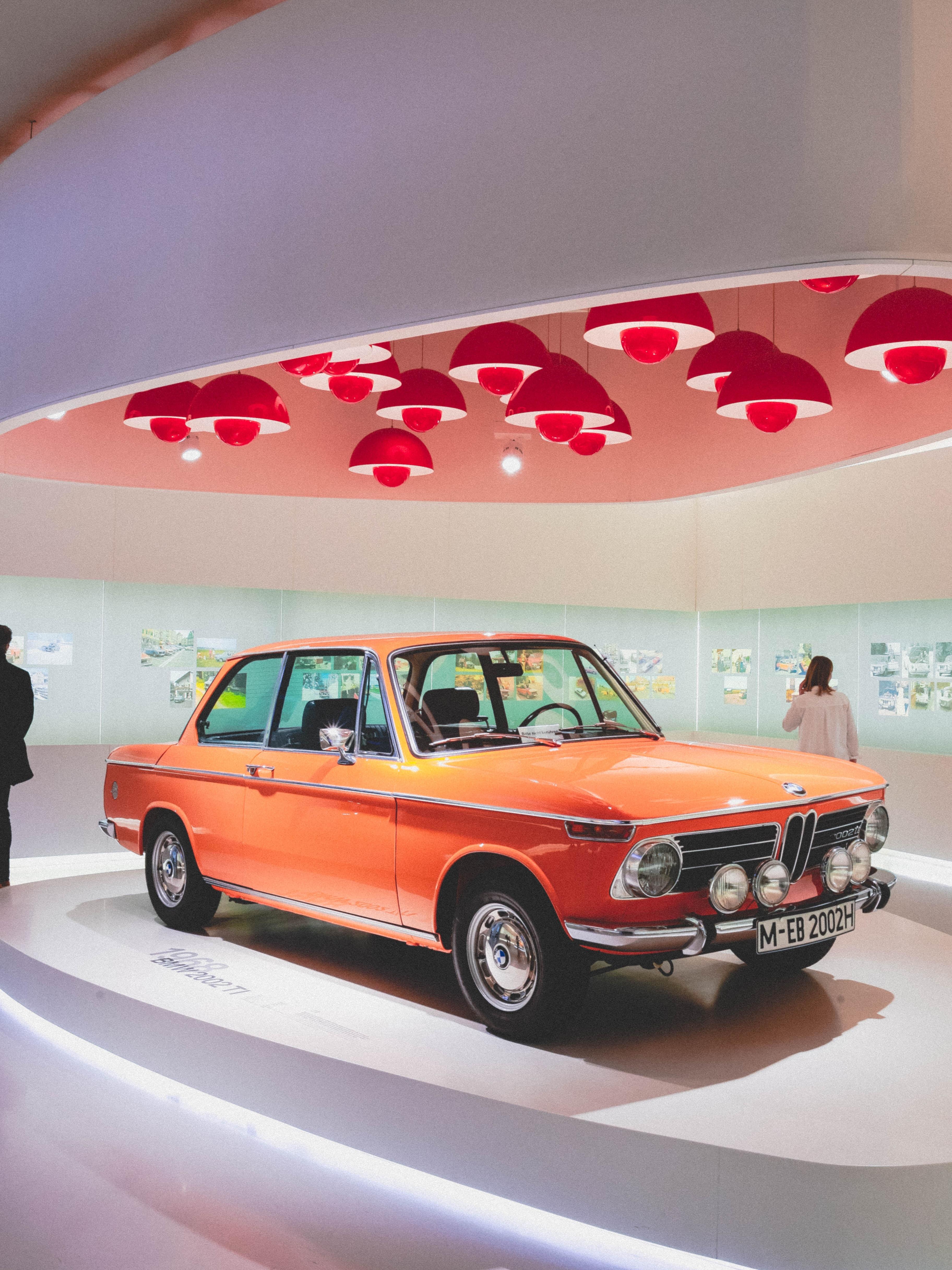orange coupe on display area