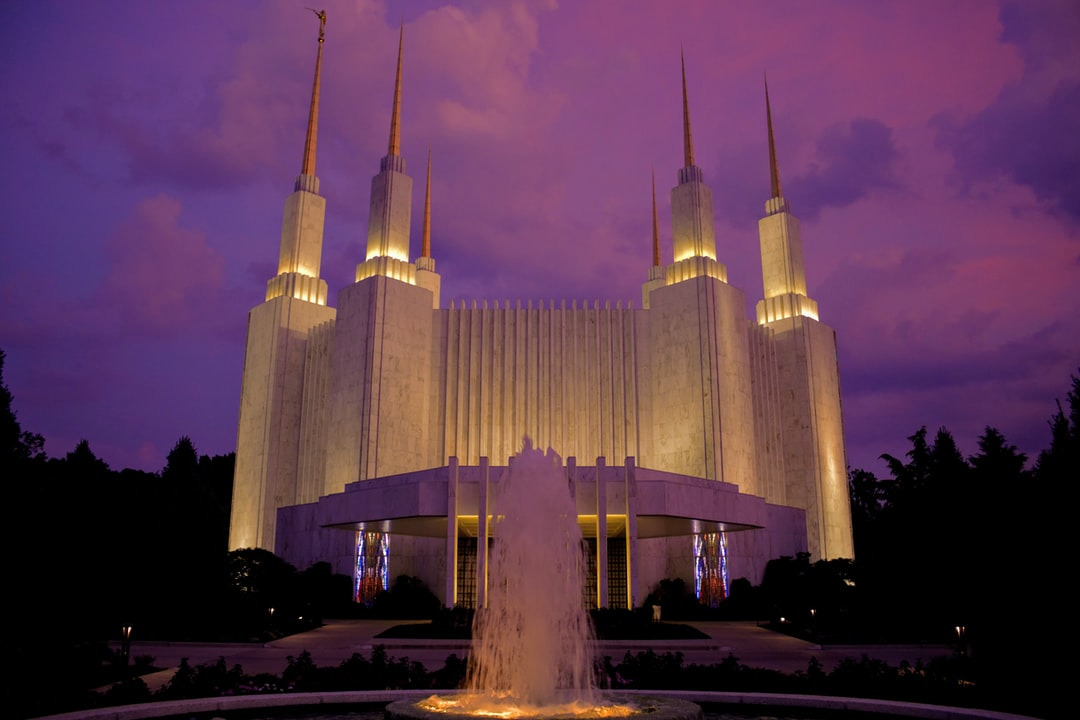 The Washington DC Temple during a summer sunset.