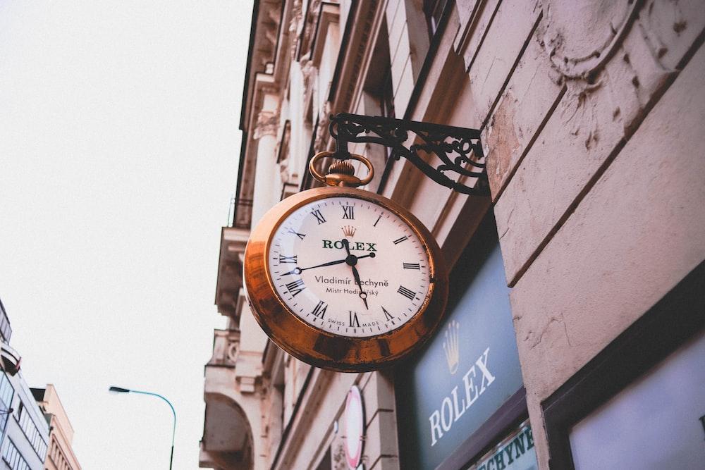 Rolex analog clock displaying 5:41