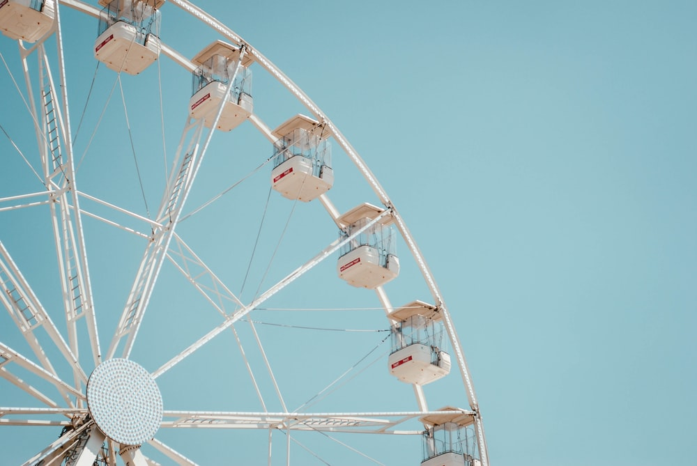 people riding on ferris wheel