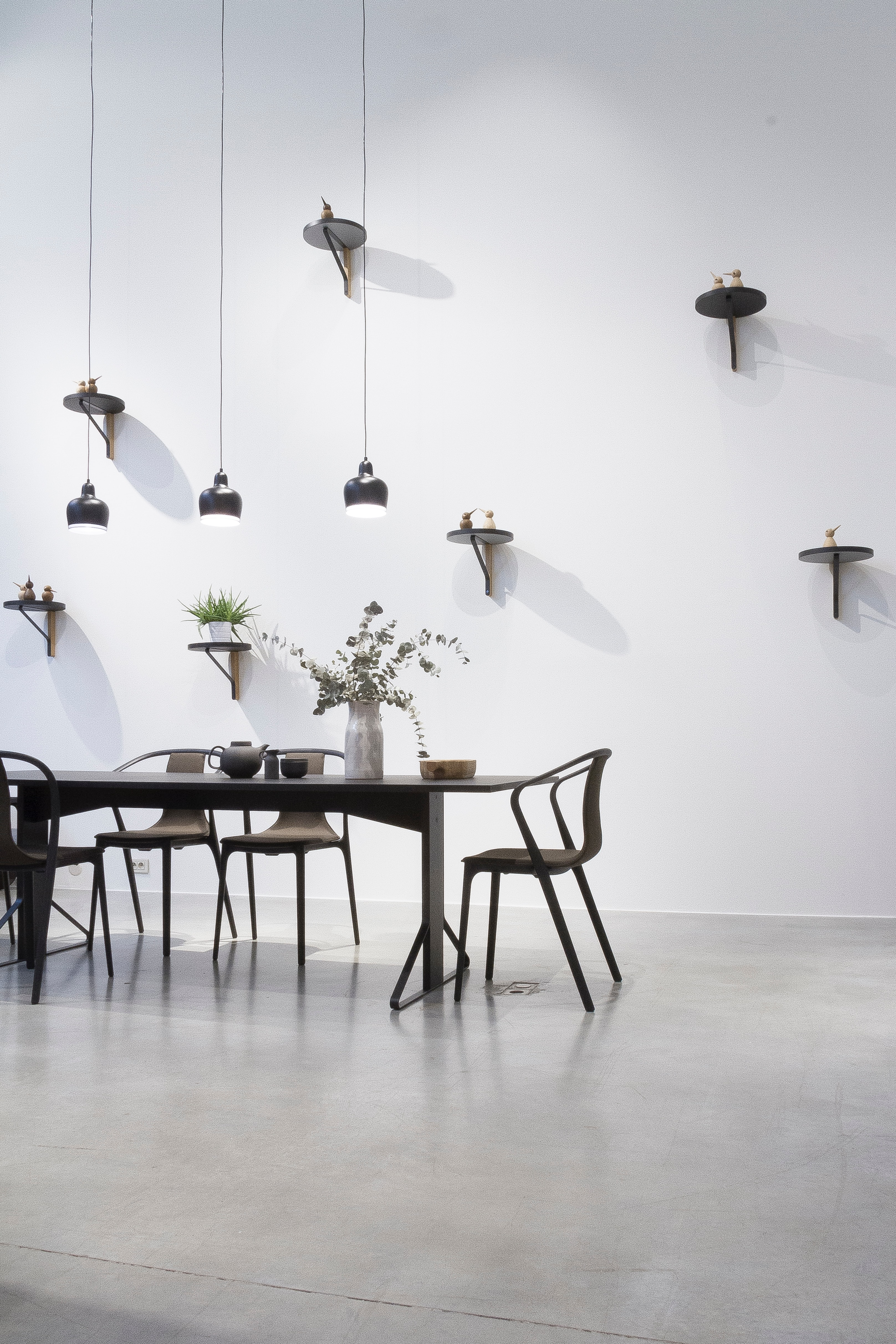 Download black dining set near white wall