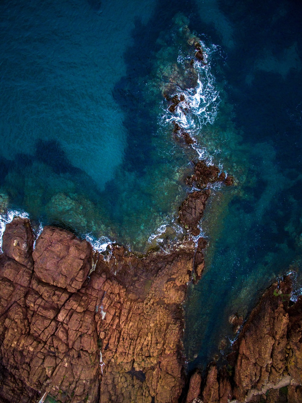 aerial view of calm sea near rock formation
