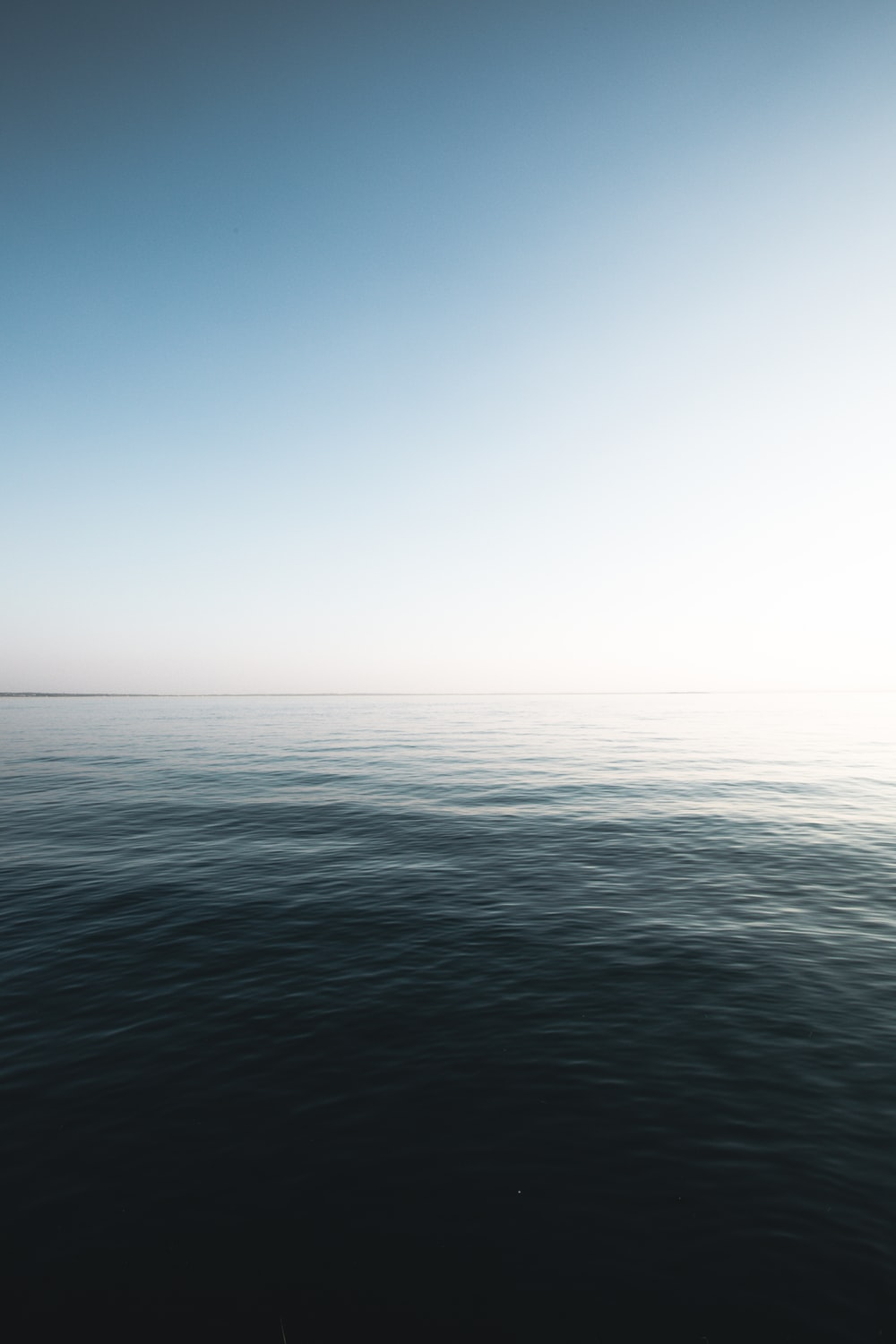 calm body of water at daytime
