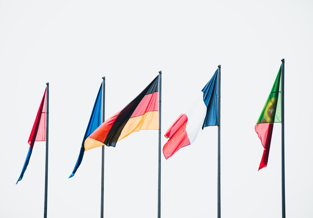 row of five flags on poles