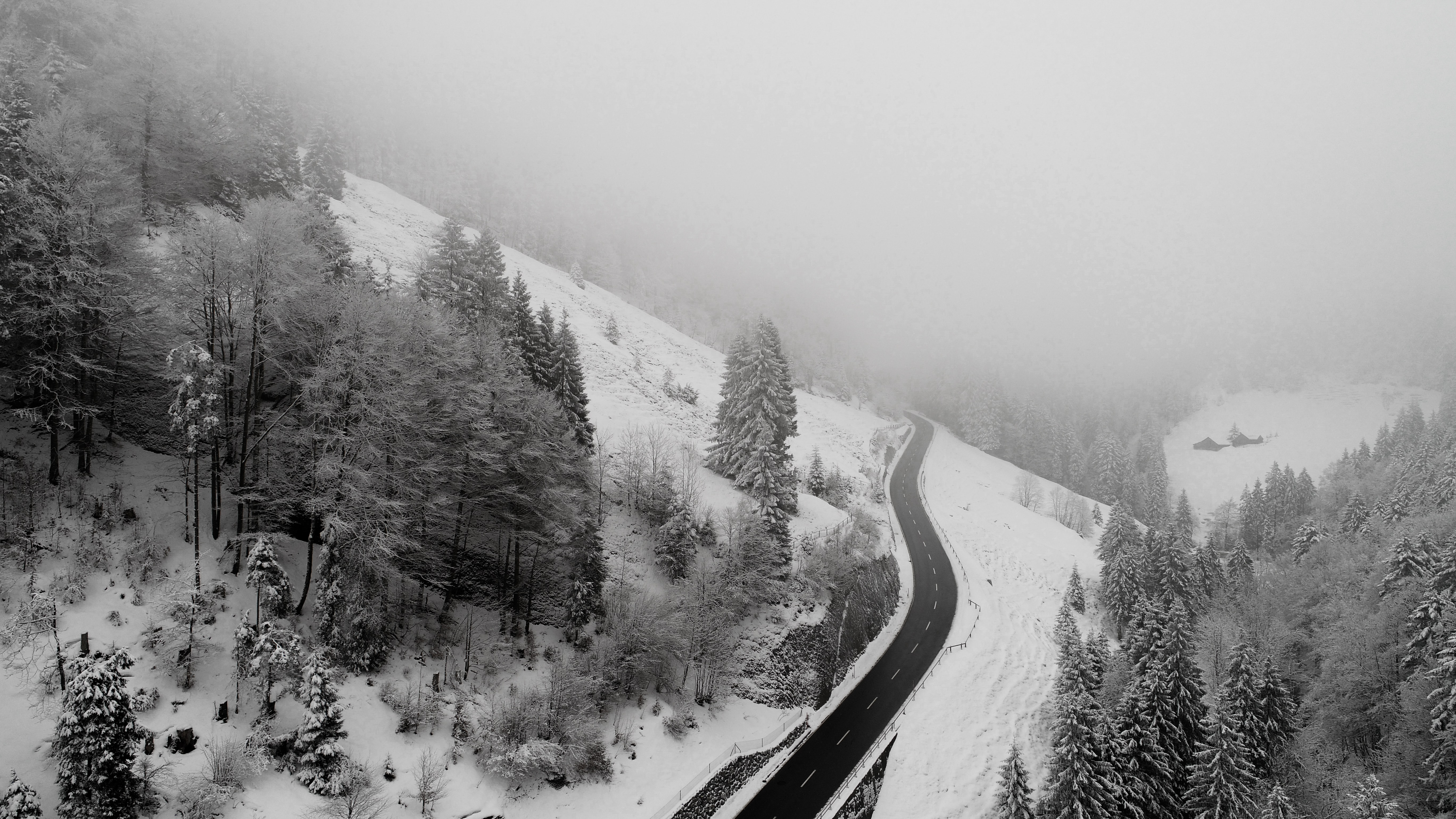 areal photography of roadway covered with snow