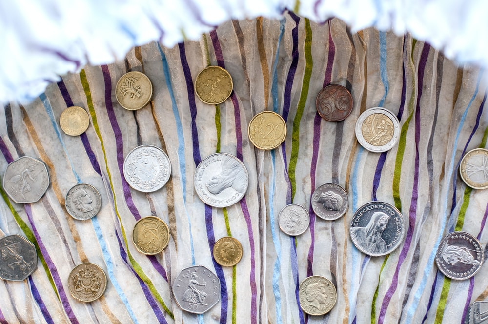 assorted values and denominations of coins