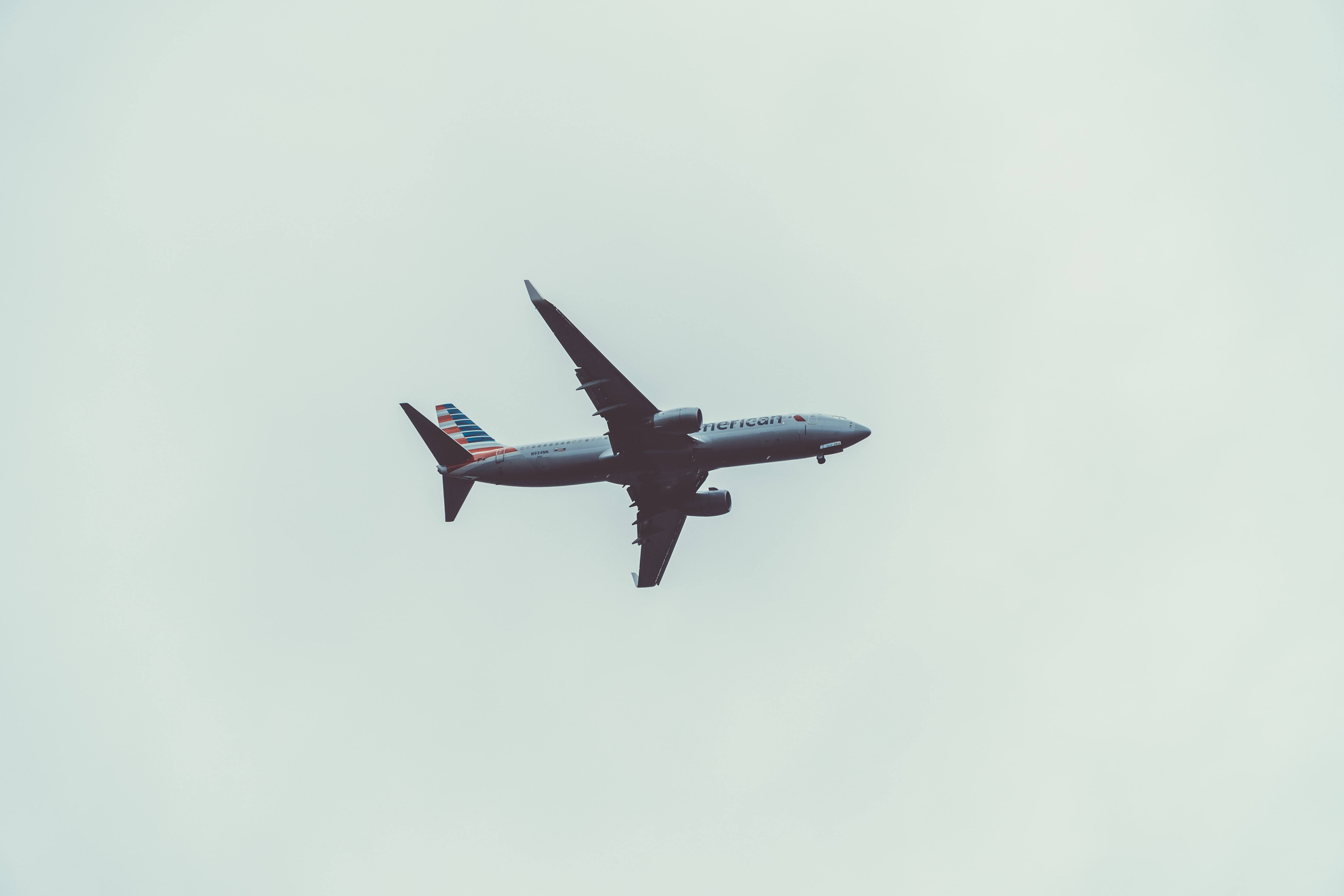 gray commercial airplane flying