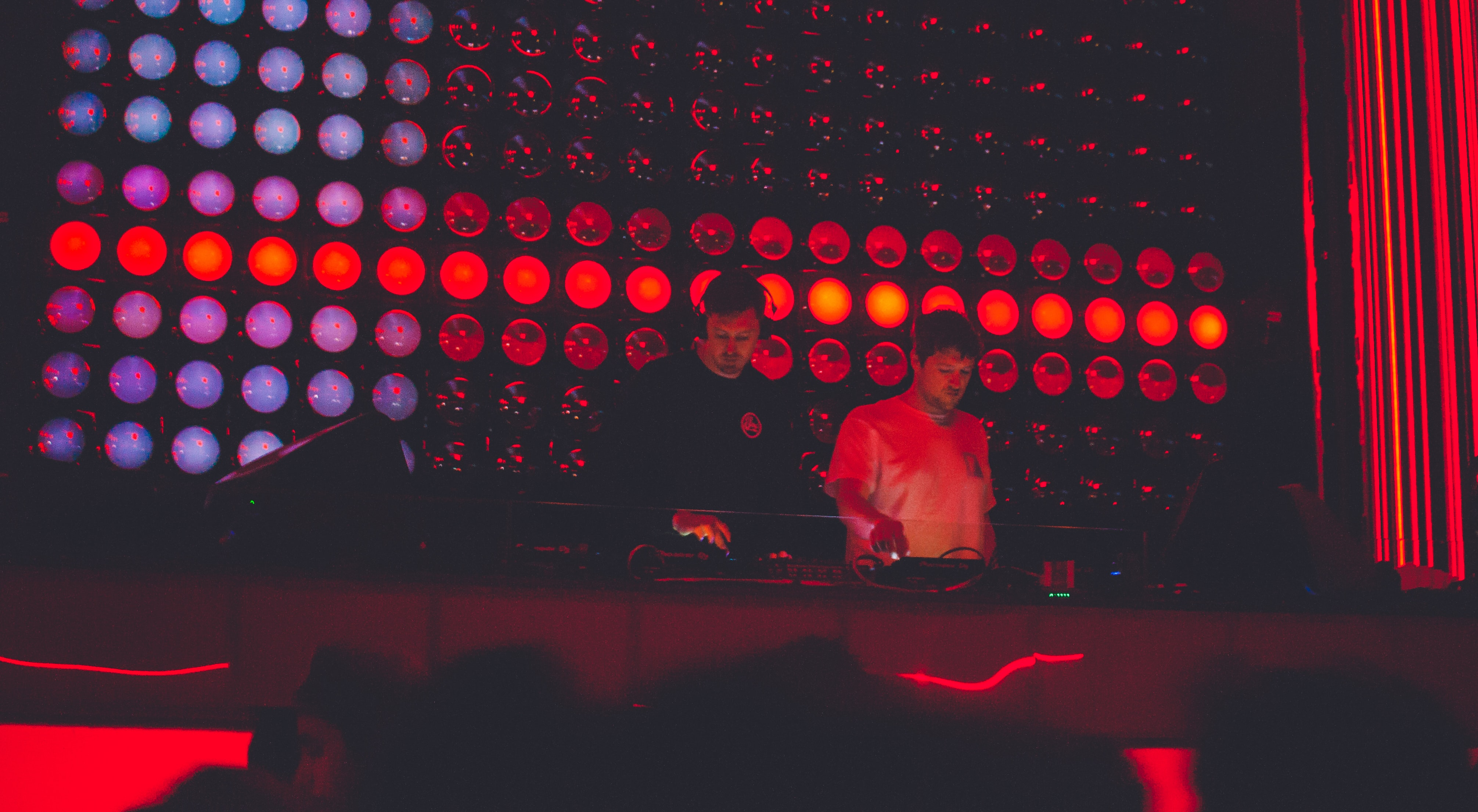 two DJ's performing on stage