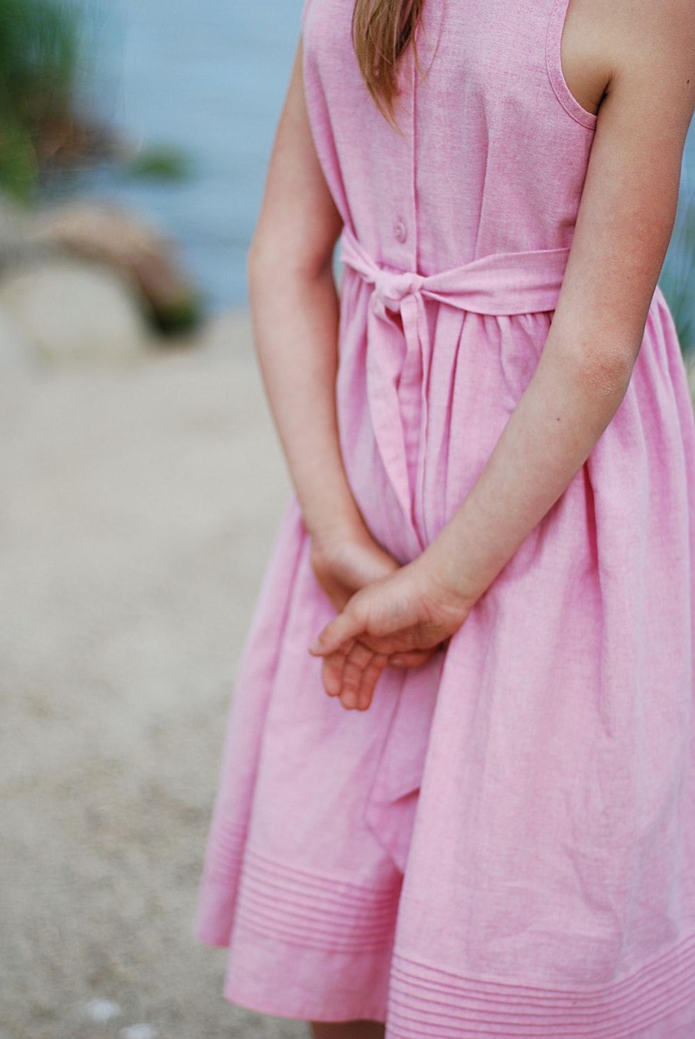 girl holding her hand backwards