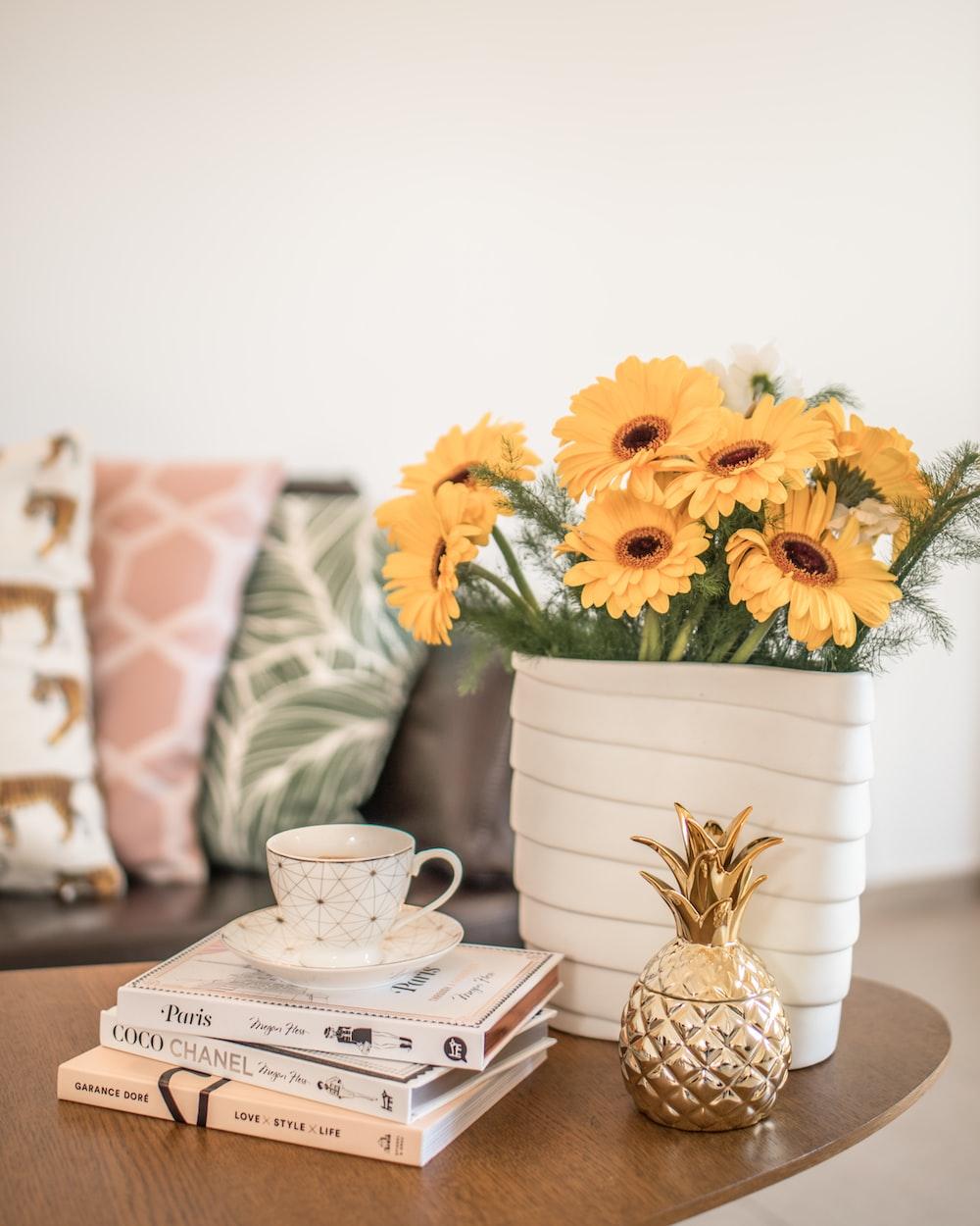 yellow flower on white ceramic vase