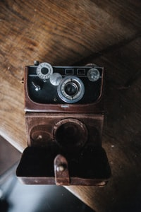 vintage brown and black camera on table