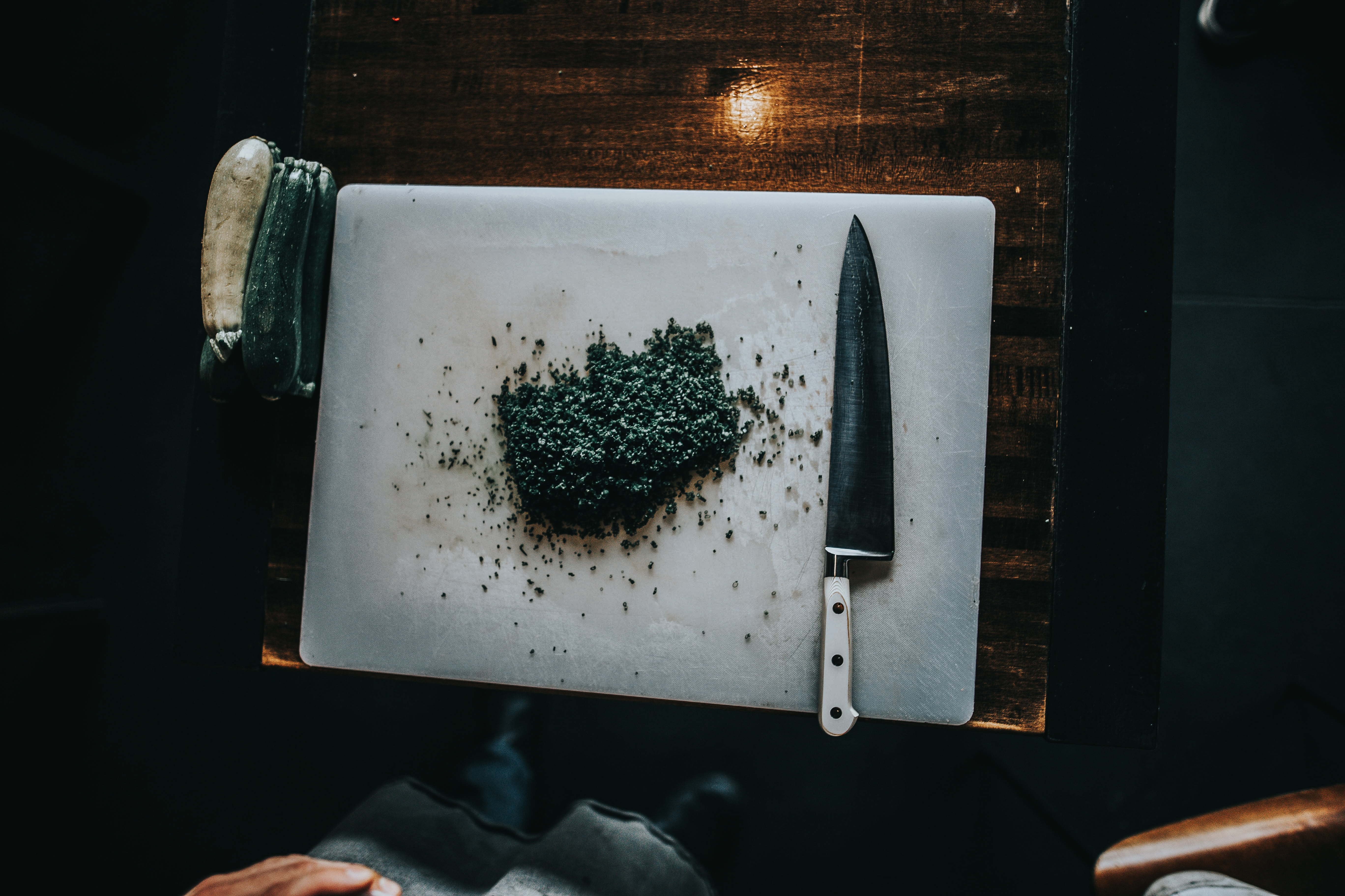 sliced cucumber with knife on chopping board