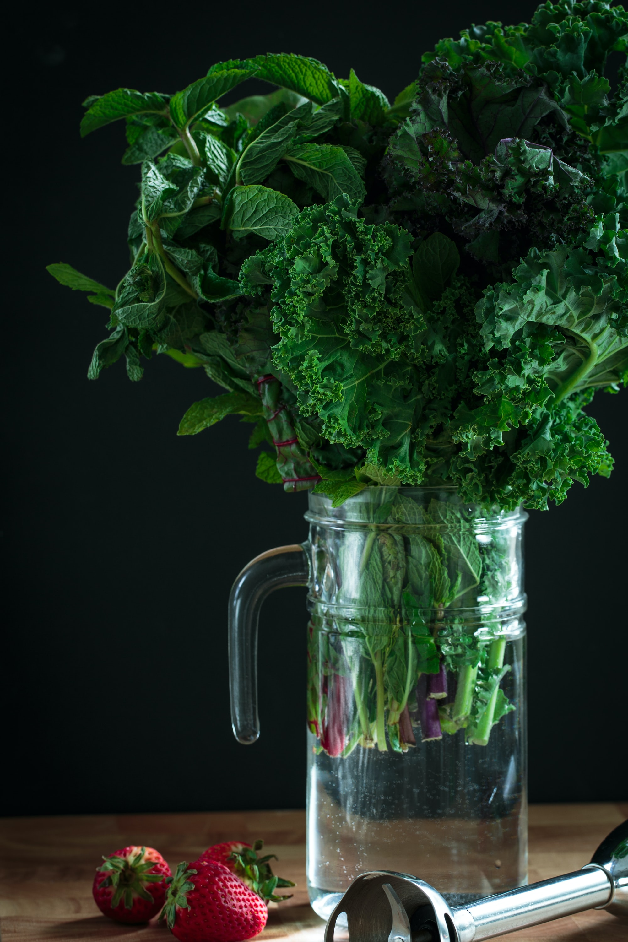 A bouquet of greens—organic green, red and black kale, organic mint, and red chard—make a unique center piece before becoming a healthy smoothie.green leafy salad, lactogenic foods