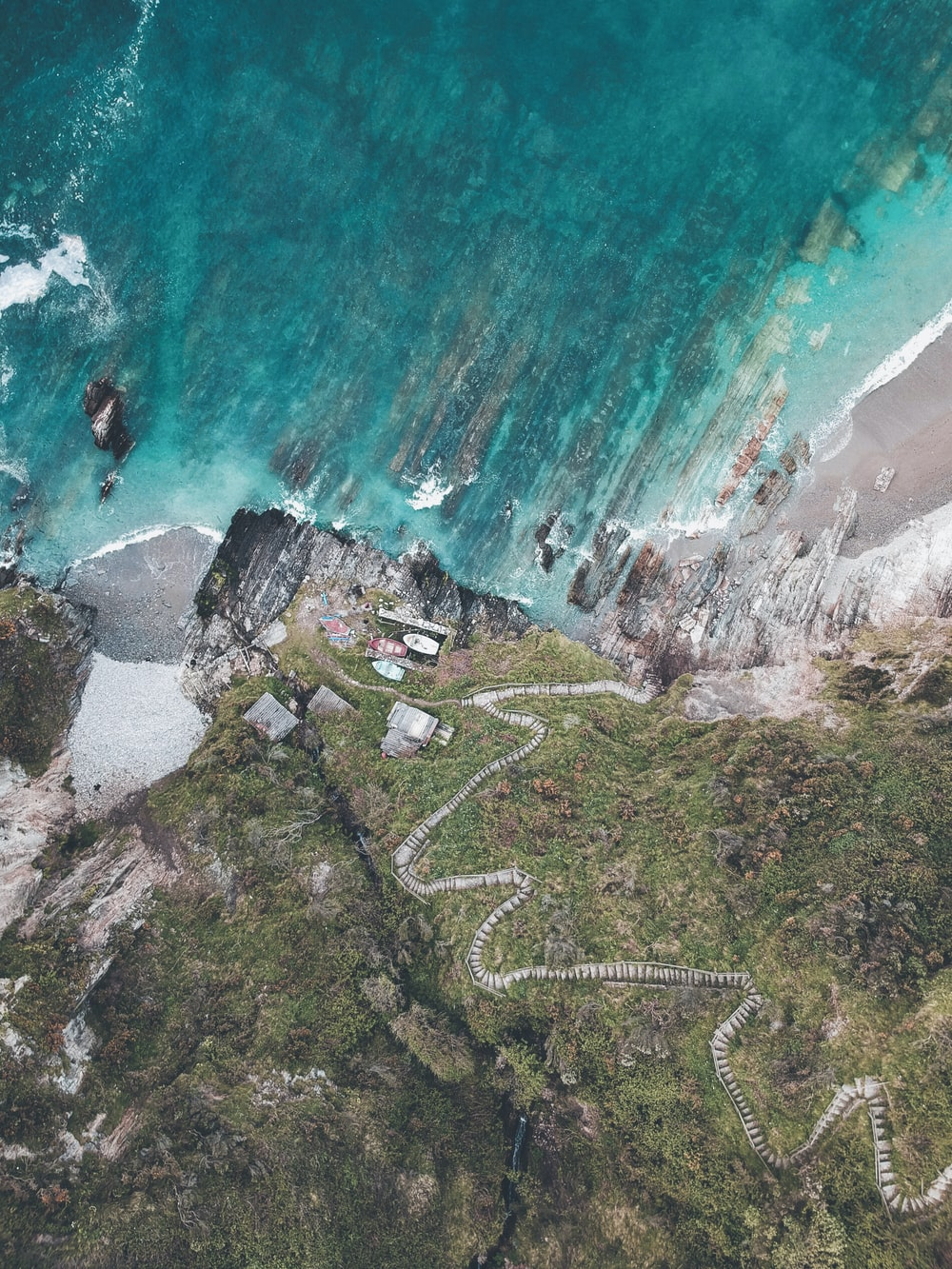 aerial photo of rock cliff stairway