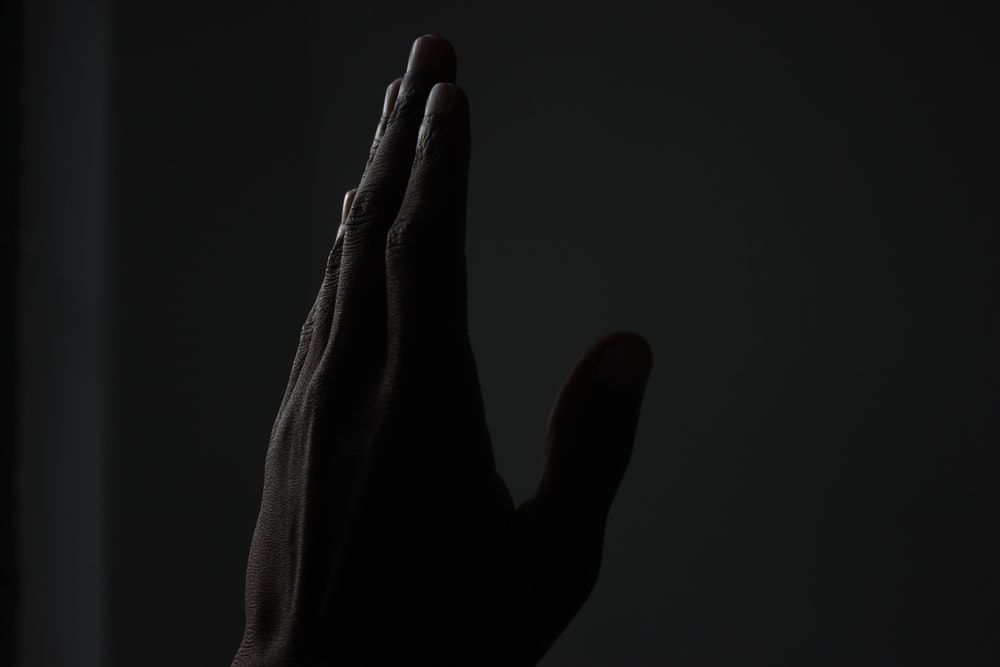 left person's hand pointing up