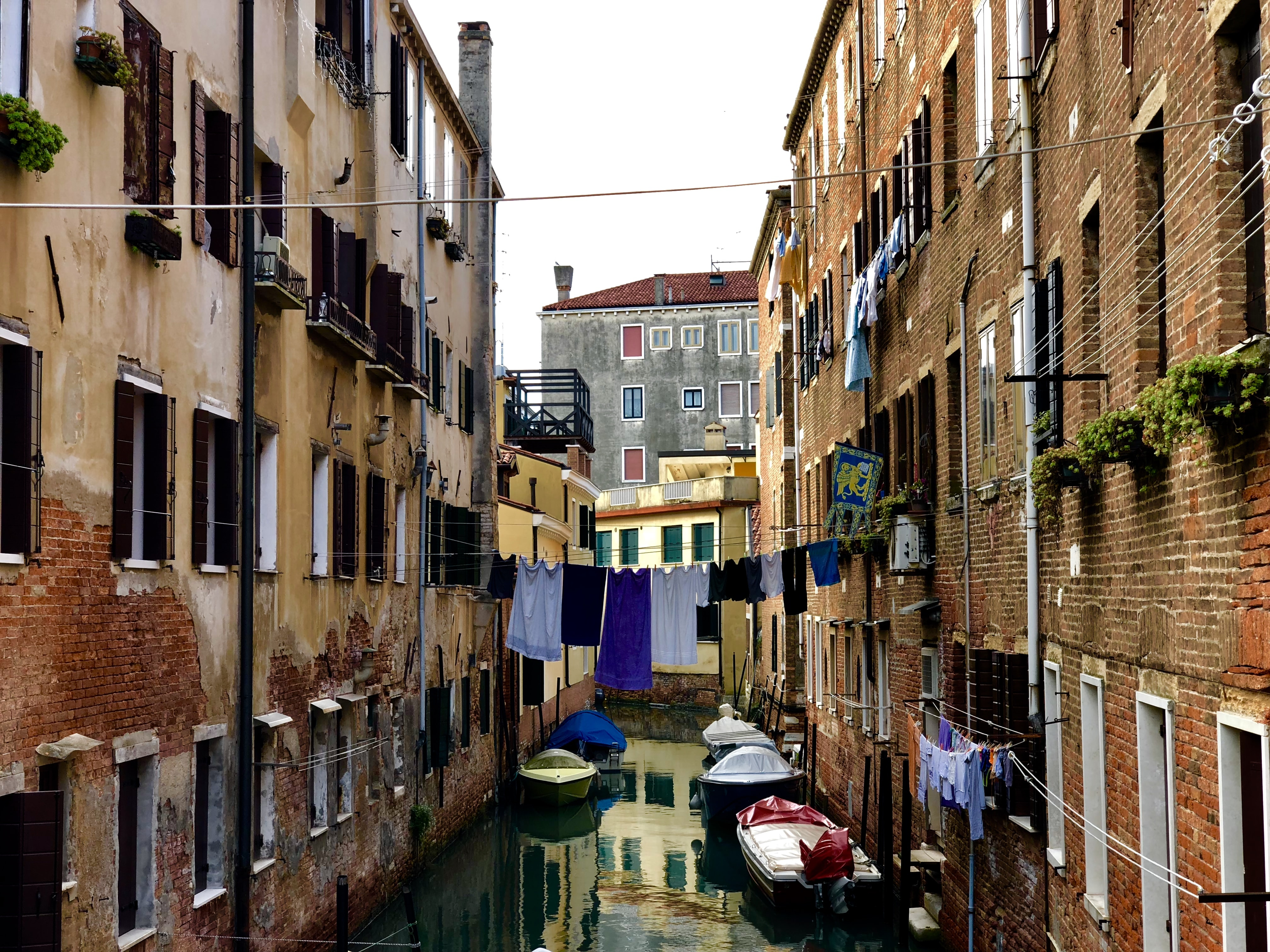 photo of canal between houses