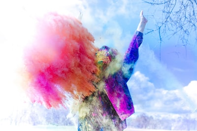 person covered by holi powder colorful teams background
