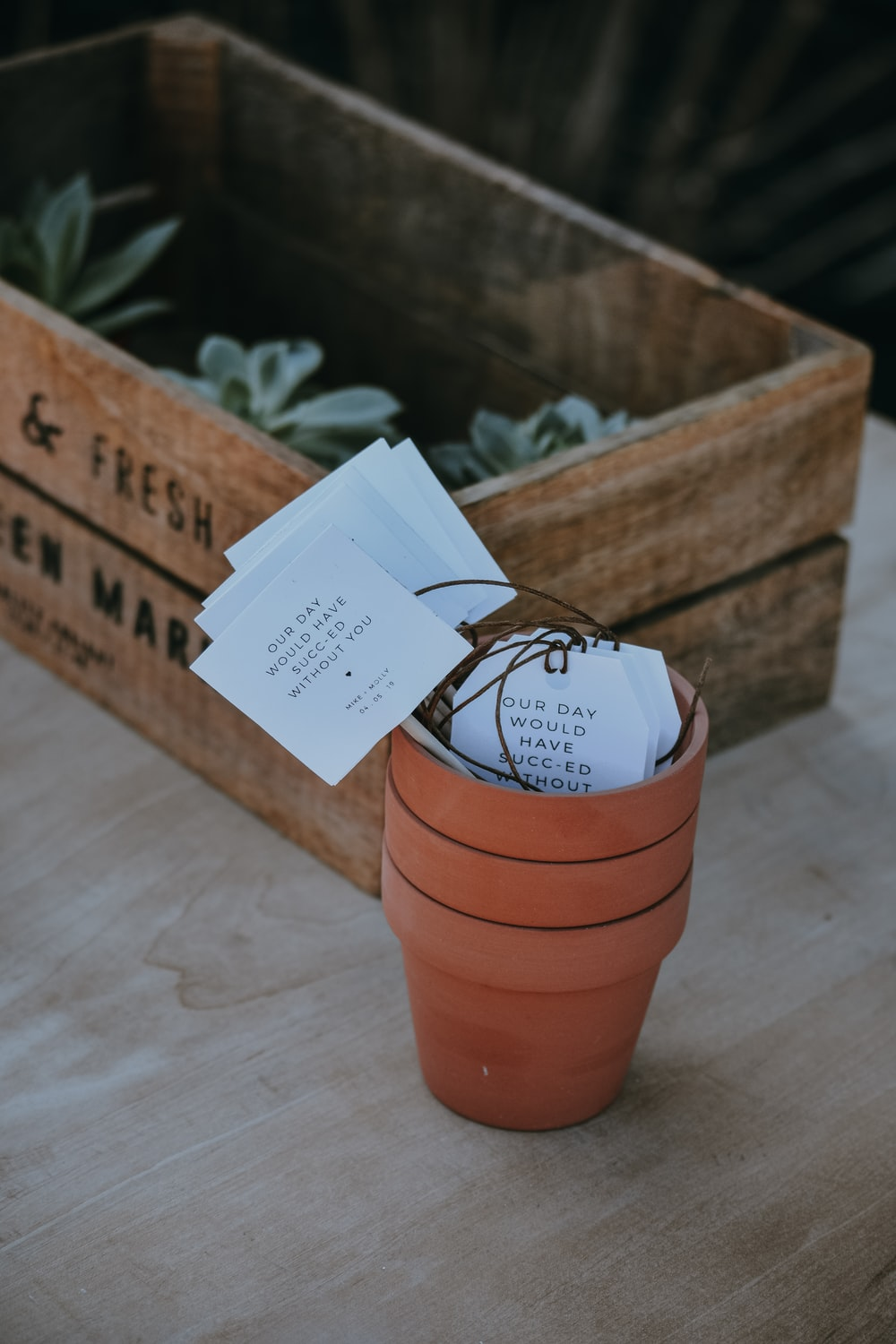 three piled brown clay pots near crate