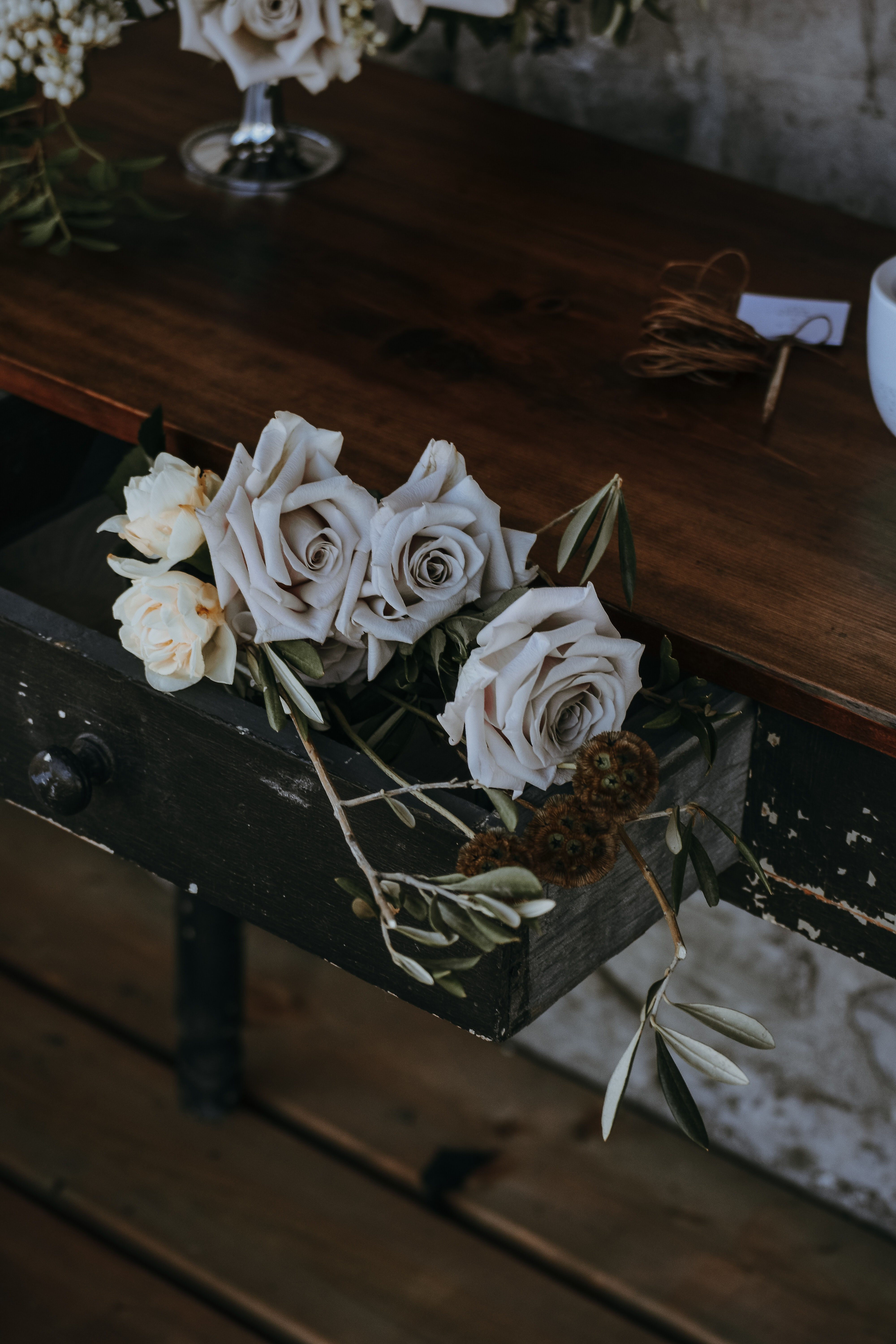 white and beige flowers on brown drawer
