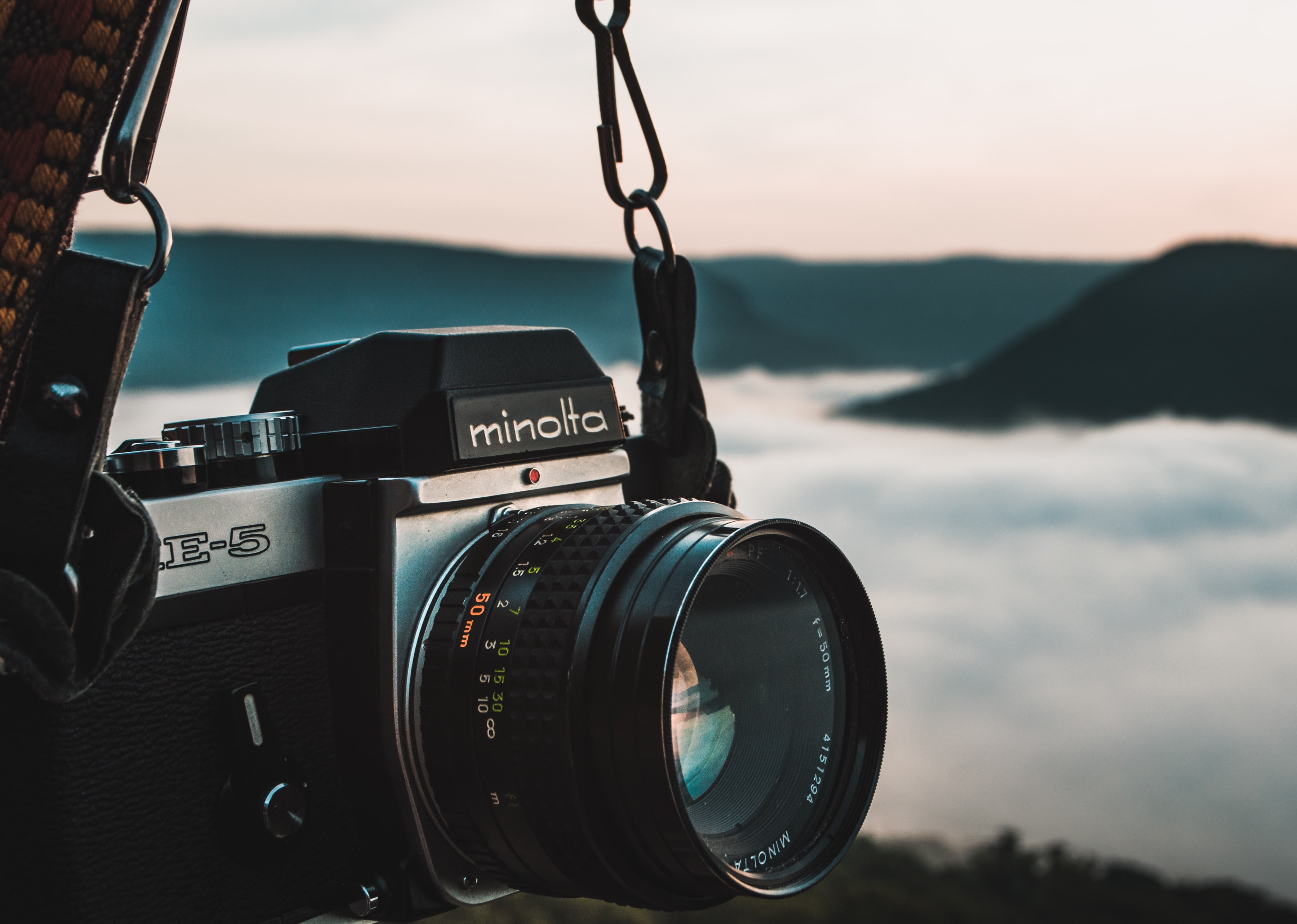 black Minolta DSLR camera