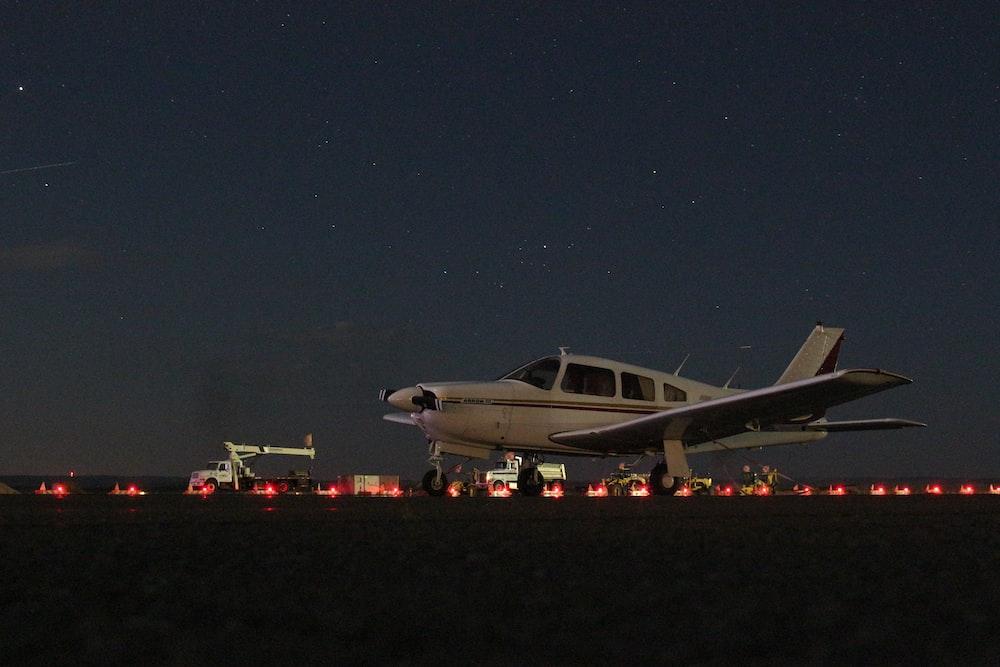 taking off white propeller plane