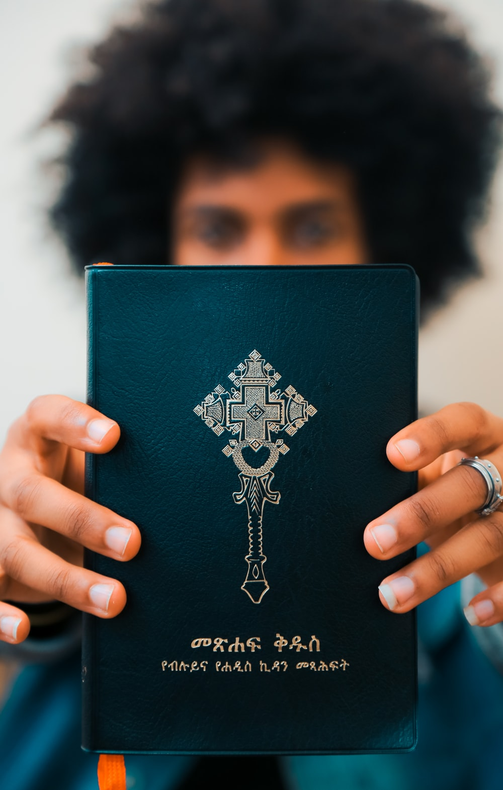 man holding book