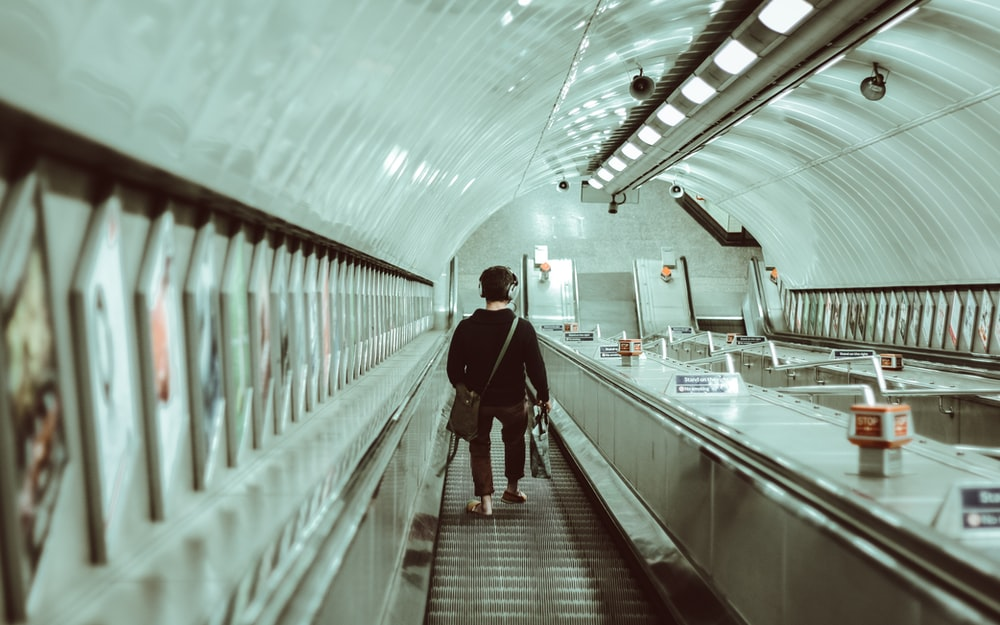 person walking on escalator