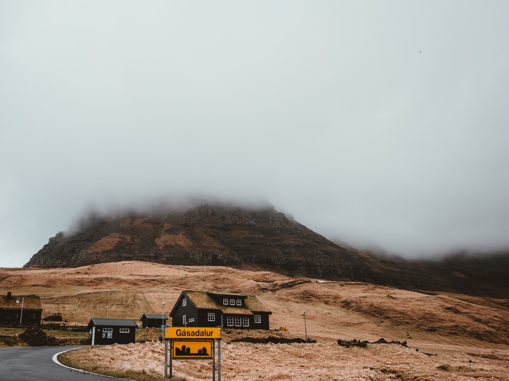 landscape photography of black house near mountain