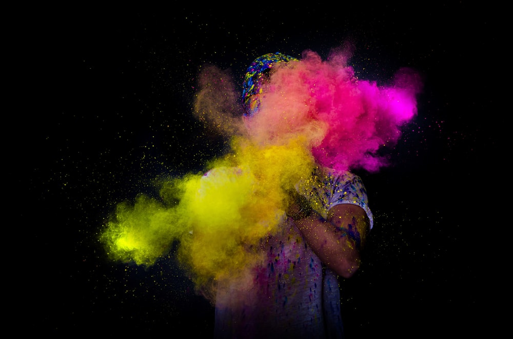 person throwing colored powder