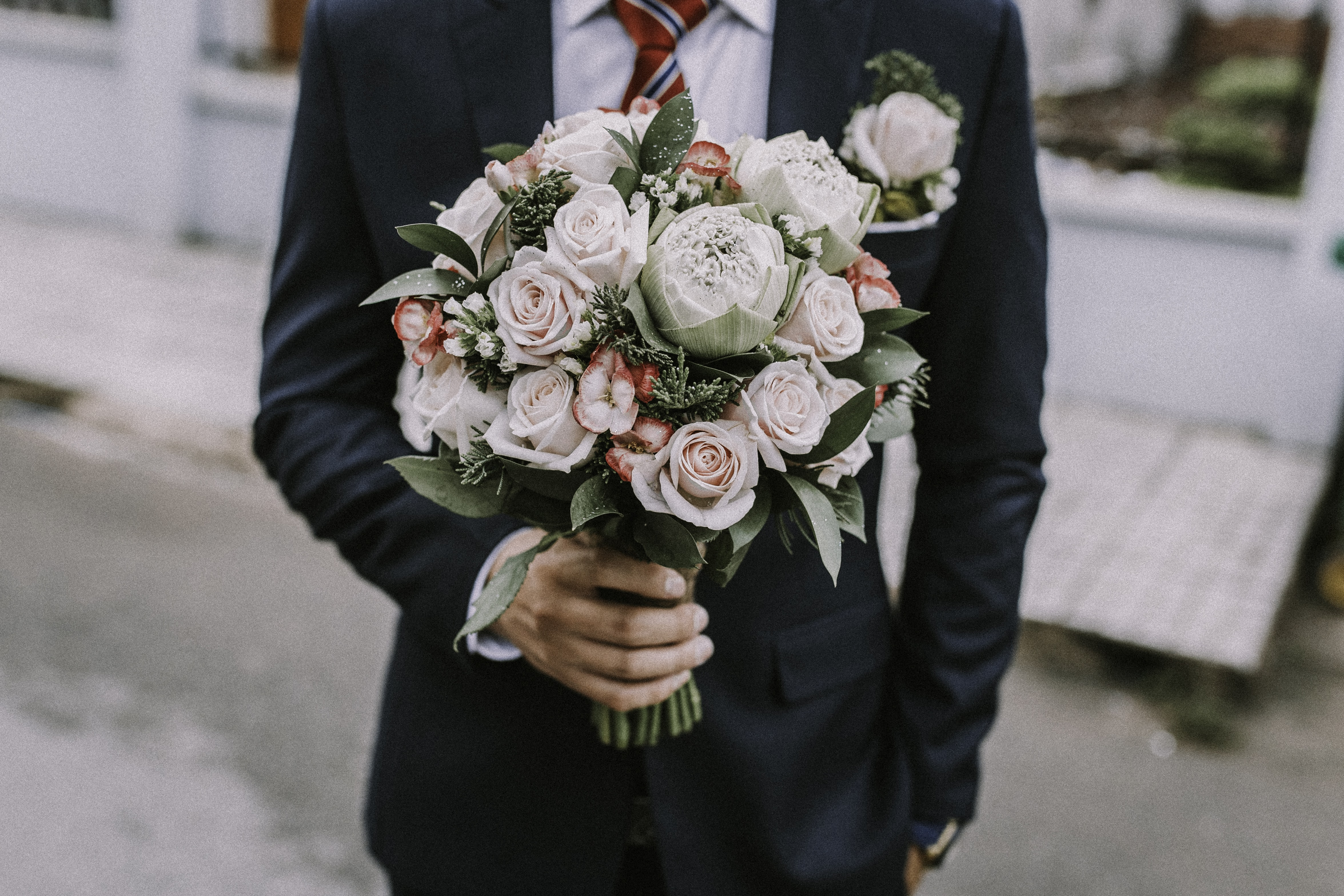 man holding a rose bouquet