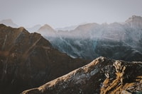brown mountains covered with fog