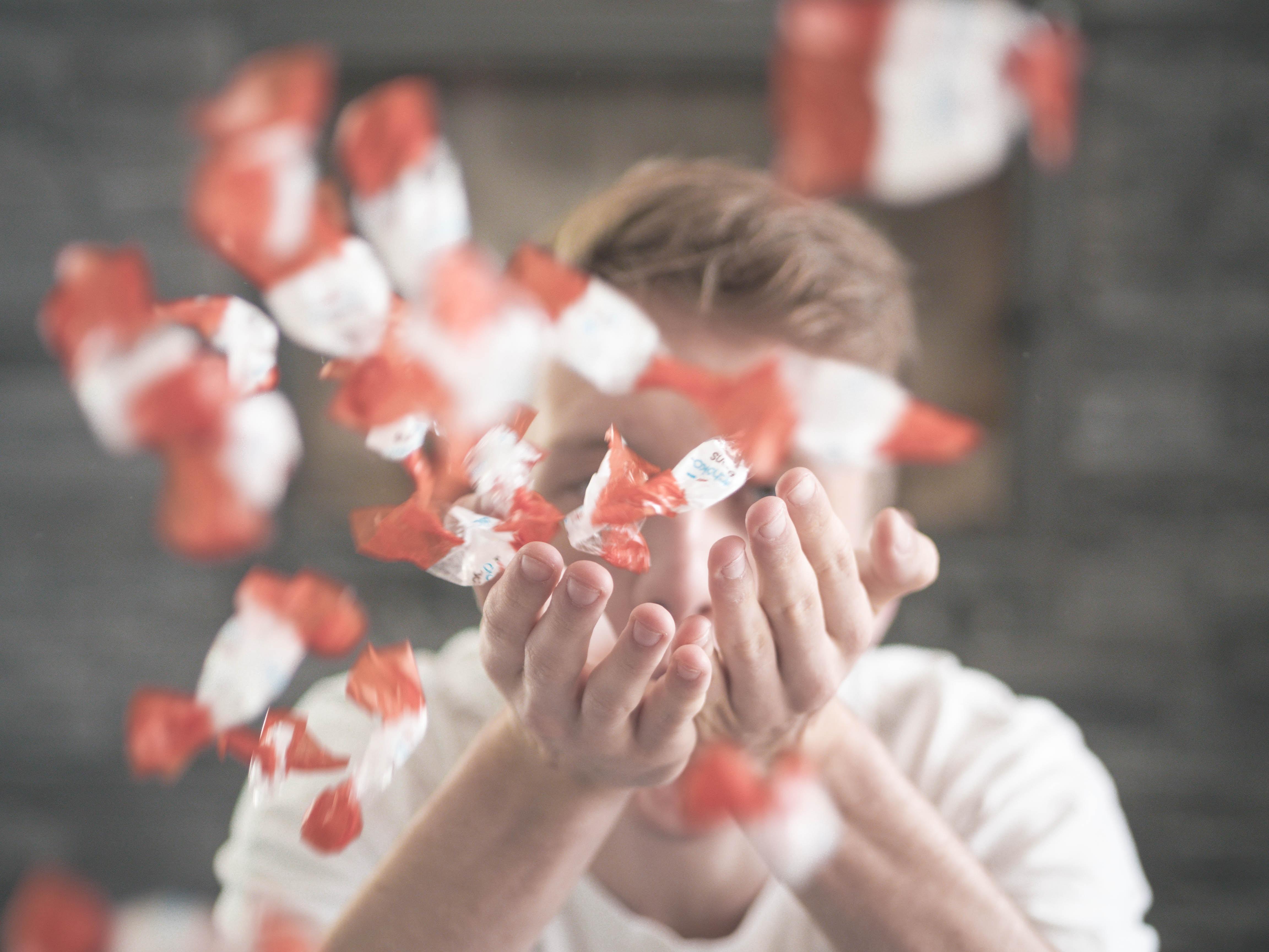 man scattering flower petals