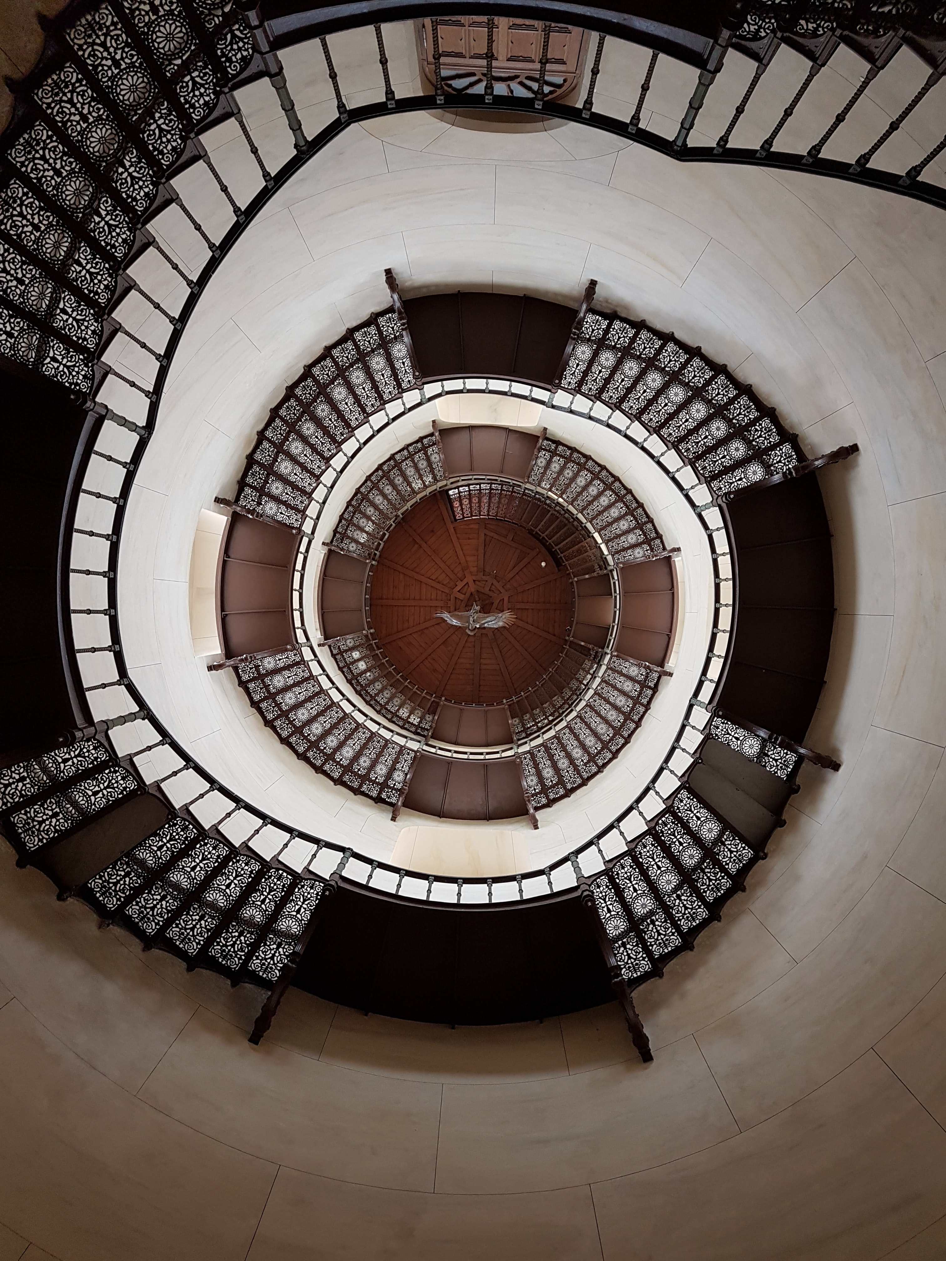 worm's-eye view photography of spiral stairs