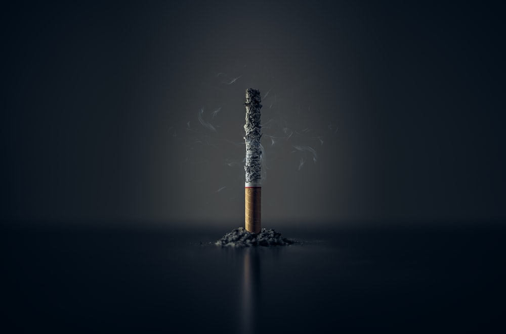 single cigarette stick with ashes stick