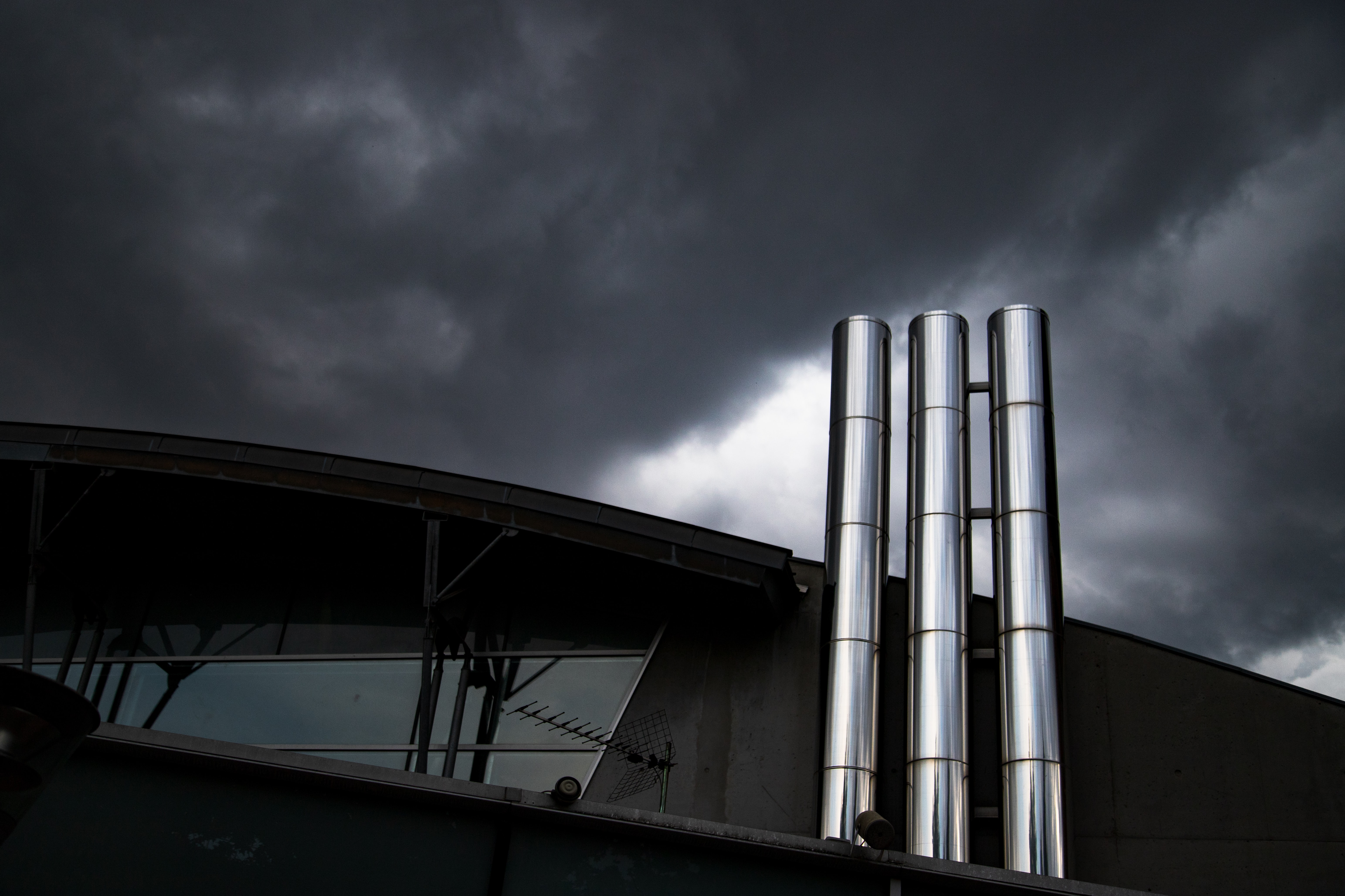 stainless steel tanks on gray cloudy sky
