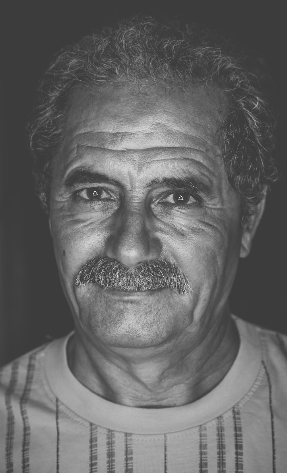 grayscale photo of man in shirt