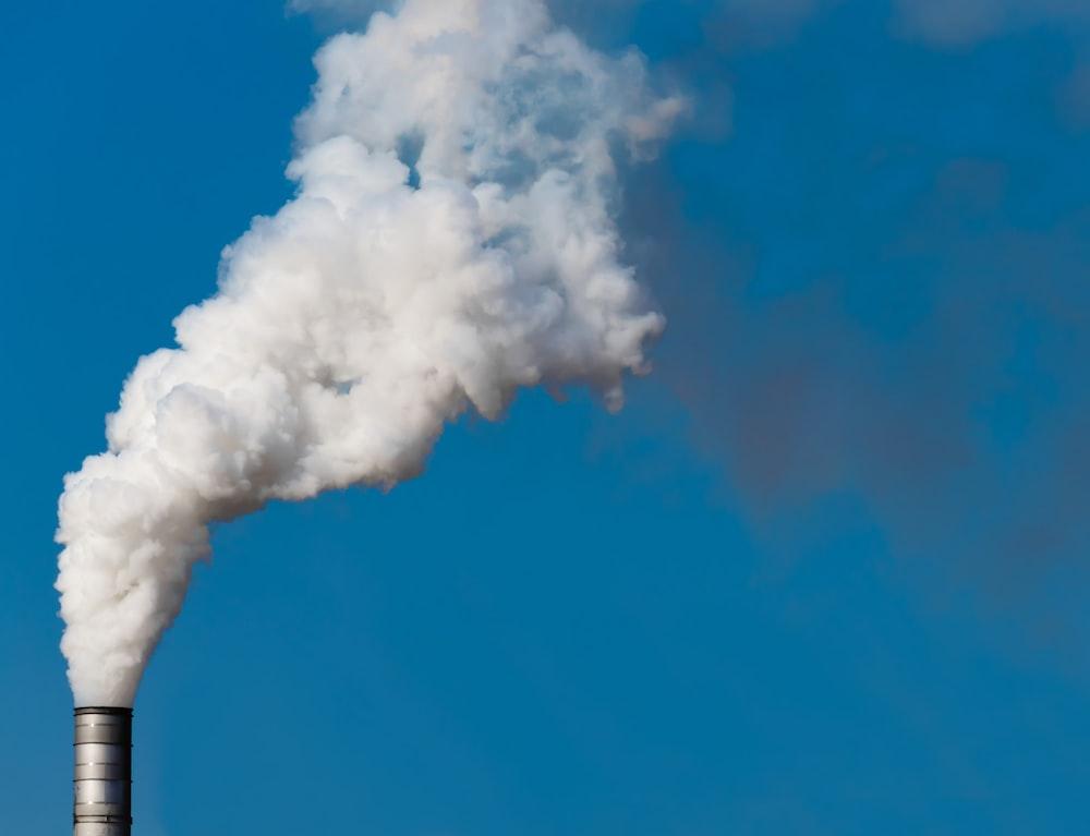 white smoke from factory chimney